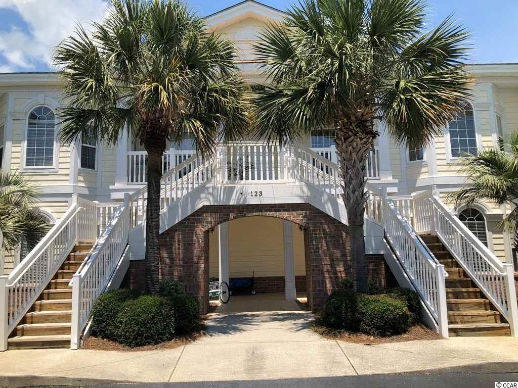 Perfect for vacation getaways or annual rental. Beautiful low-rise condo community boasts ample parking, community pool and private access to the beach. This top (second) floor, 4 bedroom, 3 bath, end condo enjoys single-level living with large foyer, cathedral ceiling and screened porch. Split-bedroom floor plan provides private layout as well as lockout option with 2 bedrooms, full bath and wet bar. Detached 1-car garage and assigned parking. HOA fee includes water and sewer, internet and basic cable. Best of all, Green Haven enjoys Litchfield by the Sea (LBTS) privileges. This oceanfront gated community gives owners easy passage to the beach by bike, golf cart or car and provides parking, restrooms, outdoor showers and an extensive sundeck surrounding the oceanfront club house. Groceries, restaurants and fitness center are conveniently located along the same route to the beach.