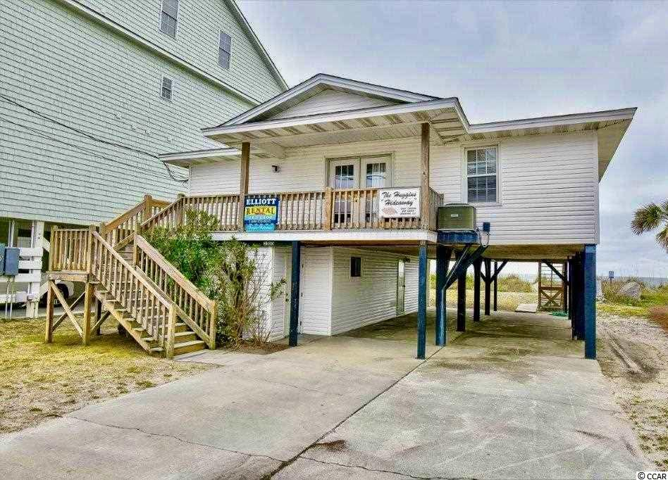 DIRECT OCEANFRONT HOME! If you want to live oceanfront, the Cherry Grove section of N. Myrtle Beach is the place. This 5br/3ba oceanfront home is located just a short walk to the Cherry Grove Pier and is in the heart of one of the most established areas along the Grand Strand. The home is currently used as a rental and has great rental income. Downstairs has a separate apartment that has never been rented and offers excellent potential. This fantastic home is located near shopping, dining, golf, entertainment and everything North Myrtle Beach has to offer. Whether you are looking for a vacation home or a great investment opportunity, you won't want to miss this. Schedule your showing today!