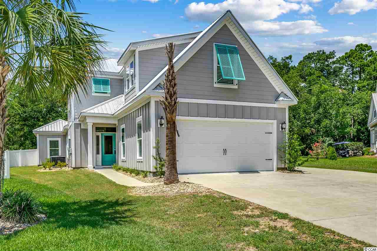 Low Country style home located at The Orchard in the heart of Murrells Inlet. Custom built in 2017 home features outstanding upgrades, 4 bedrooms 3 1/2 baths, owners suite on the ground level with coffered ceiling, walk in tiled shower, double vanity, large linen and walk in closet. also on the main level you will find a carolina room, large living room, generous size kitchen with stainless steel appliances, 42inch cabinets, breakfast bar, work island, extra cabinets with plenty of storage, powder room, washer & dryer, stop & go area, plantation shutters throughout, and beautiful brazilian wood flooring. The 2nd level features 3 bedrooms and 2 baths, one of the guest rooms has a private bath and can be used as a second master suite. There is so much space for storage in this home, a delight for most homeowners. Outside living will be enjoyable sitting under the pergola that is equipped with LED lighting and a large cedar storage with a granite bar top, fenced backyard, an oversized two car garage, plentiful concrete drive, and also an additional concrete pad for boat parking. This is a one of a kind home, extra thought and care was placed when home was built. The Orchard community is in the heart of Murrells Inlet, close to the public boat landing, yummy restaurants, the well known marshwalk, fishing, the ocean, Huntington Beach State Park, Brookgreen Gardens, and so much more. All measurements and square footage are approximate and not guaranteed. Buyer is responsible for verification.