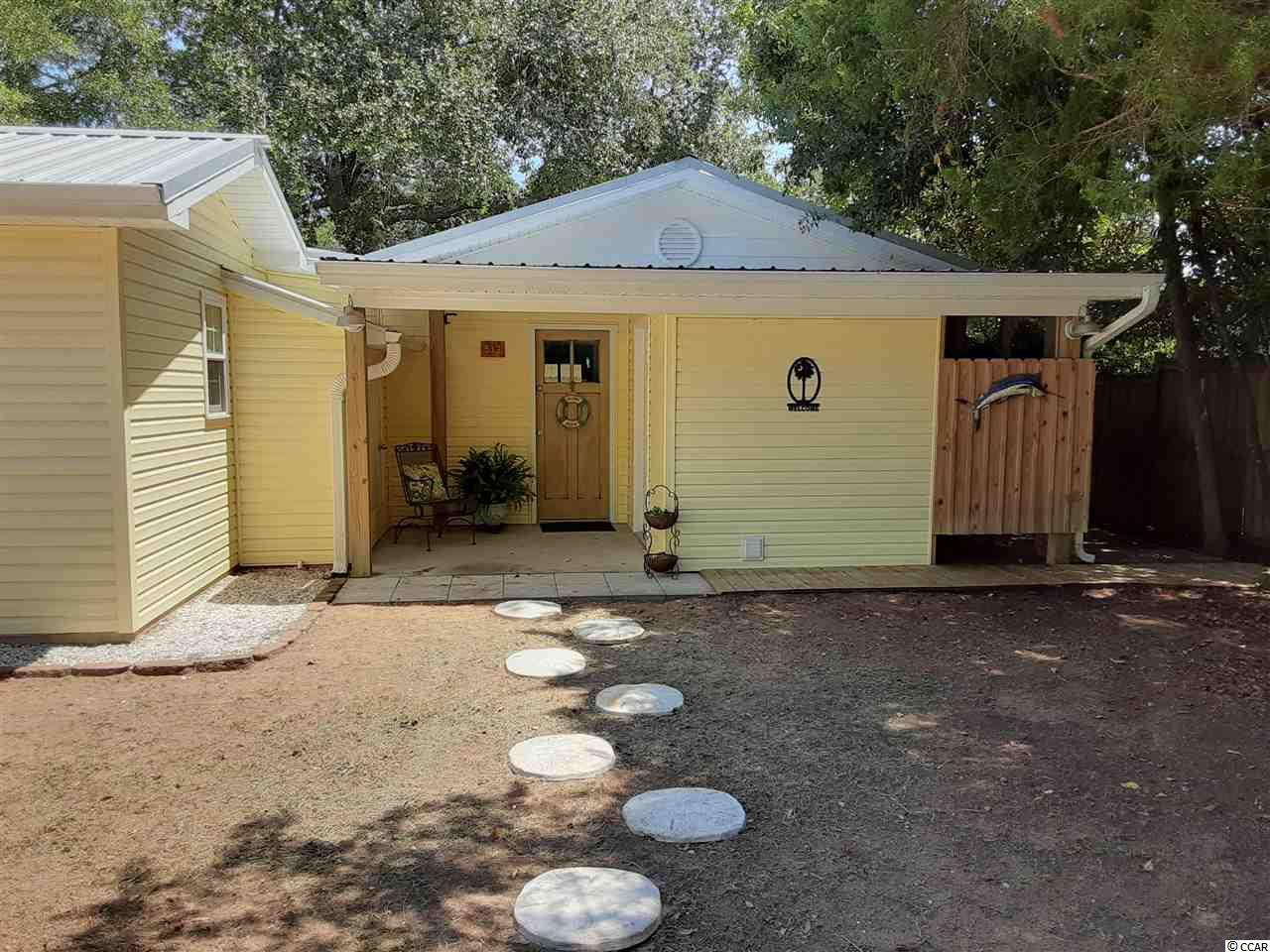 """If you are looking for a truly """"Hidden Gem"""", This Is It!! Totally remodeled in 2014. Thermal windows, outside bathroom, detached carport and storage. Lots of room for your boat, jet skis, golf cart and more. Wonderful marsh views from screen porch and large deck. No HOA. Appraisal done on 7/17/20 at 299,000. Motivated seller and will consider owner financing."""