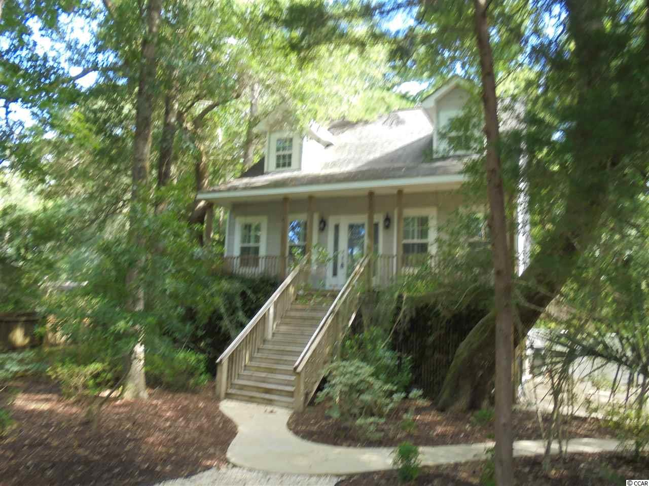 Located in Pawleys Island,America's oldest sea-side resort on a private road with minimal traffic ,this is not a cookie cutter home This home has real hardwood floors and tile.The main floor has nine foot smooth ceilings with wide crown molding in Great room,master bed and bath(with two sinks) Kitchen with stainless appliances and granite.There's 50 recessed light that have been converted to LED and 2 electric on demand water heaters and another water heater under kitchen sink for immediate hot water .The first floor bonus room could be a mother-in-law suite,4th bedroom or could be easily converted to handicap living area.Two decks and front porch totaling over 500 square feet of exterior living.The siding is a high grade vinyl cedar shake for low maintenance. The boat landing into the Waccamaw River is just a mile away or if you prefer the uncrowded beaches, amazing golf courses,shopping and restaurants, its a short drive. The HOA is voluntary but there are benefits to joining see hagley estates.com. No grass to cut.The owner also has the lot behind this home and will sell to buyer only