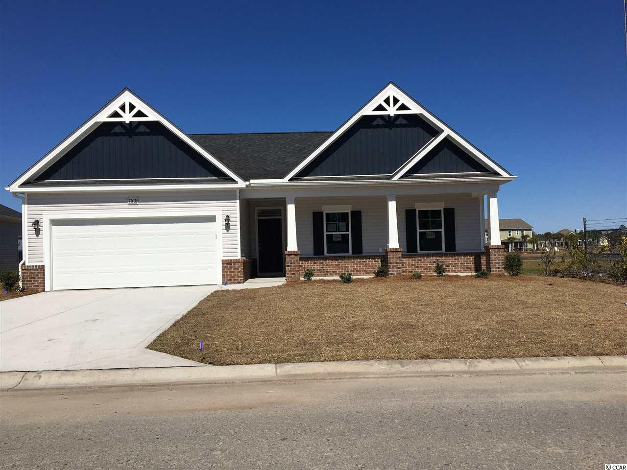 """This Frisco home plan is now offered in the beautiful community of Clear Pond at Myrtle Beach National. We are centrally located in the Carolina Forest area with easy access to all Myrtle Beach has to offer.  Lots of low country style with Large Front and Rear porches to enjoy your pond view. Walking distance to the completed amenity center with 2 pools, fitness, weight room, Club house and play ground. Low HOA fees.   This home has 3 bedrooms and 2 baths. Our design team has added the following features to this home: Additional can lights in the kitchen and Great room. Gas line for the Frigidaire traditional gas appliance package which includes the gas range, microwave, dishwasher and garbage disposal. Granite counter tops in the kitchen with large island and pendant lights. Crown molding on the kitchen cabinets which are in a Ivory color. 5"""" Laminate in the foyer, hall to bedrooms, family room and kitchen/casual dining areas. Tile in the baths and laundry. A ceiling fan has also been added to the Master bedroom and Great room. The Master has a 5' shower, double sinks and large walk in closet. Master also has a trey ceiling.   Picture for representation purposes only until this home is completed. Estimated completion March 2021."""