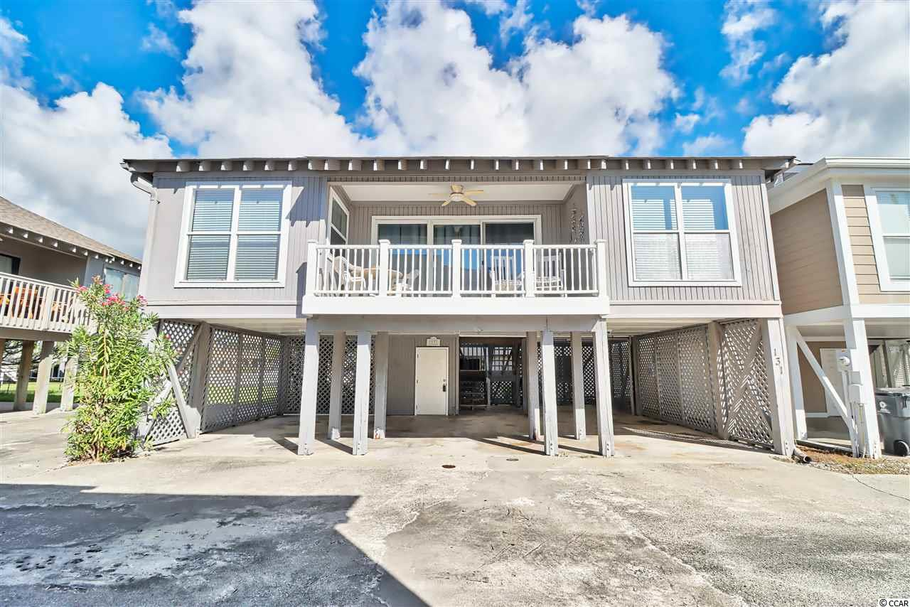 This charming beach getaway is just a hop, skip and jump one block from the beach. This home features three bedrooms, two baths, full kitchen, breakfast bar and balcony. Community has a pool and there is ample parking underneath. Full size Washer/Dryer located in storage area on ground level. This unique opportunity puts you a block off the beach without spending a fortune! If you were looking to dip your toes in the Atlantic without breaking the bank this is it! Call Today!!