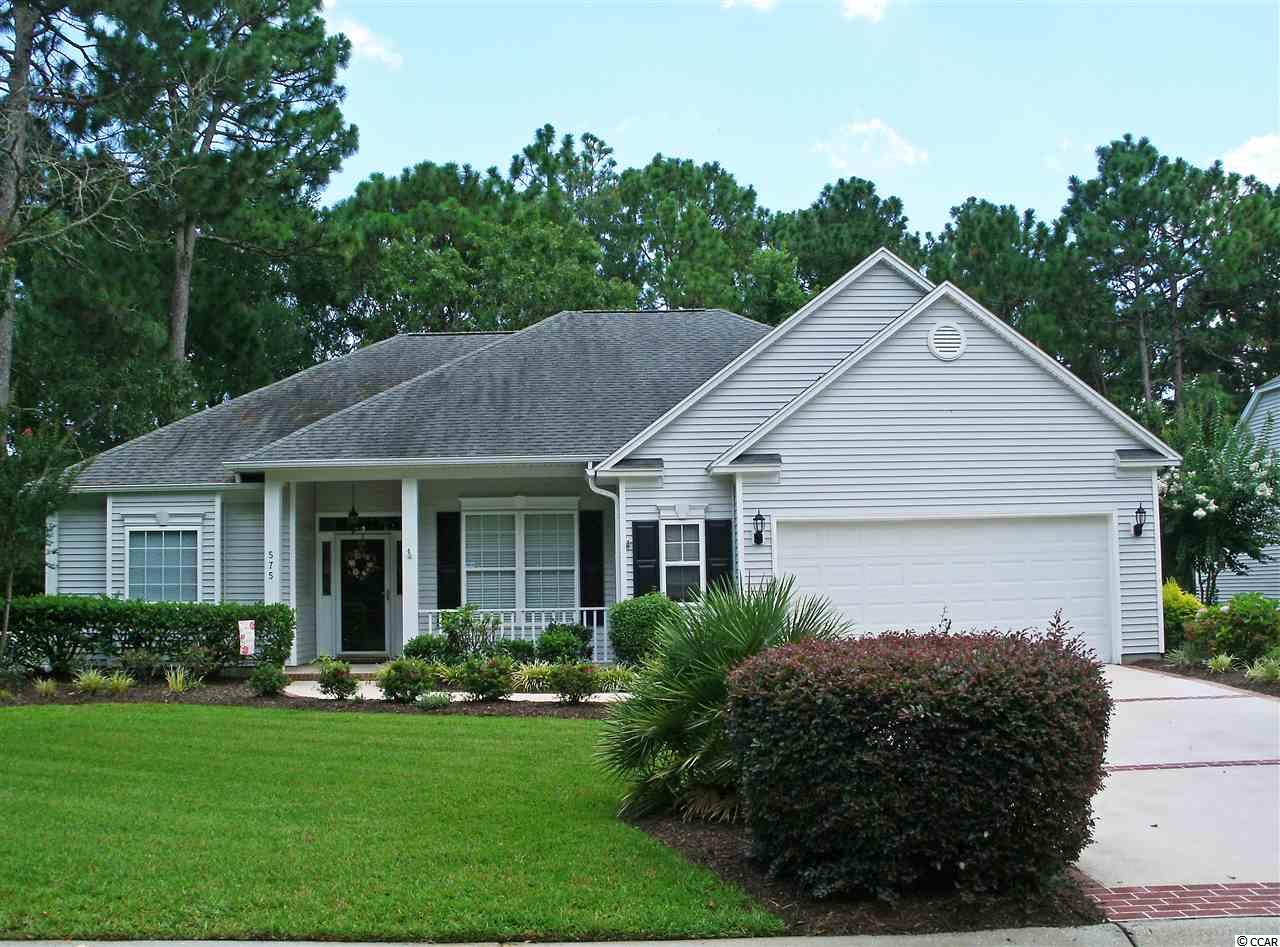 Lovely Tradition Club home boasts single-level living with private setting. Sweeping golf greens edged with open woodlands wind through this golf course community providing abundant natural beauty and privacy. The split-bedroom floor plan brings additional privacy within this 3 bedroom, 2 bath home. Formal dining room with glass French doors could also be office or den. Central common areas with cathedral ceiling opens out to spacious, climate-controlled Carolina room. Attached two-car garage. Property owners enjoy Litchfield by the Sea (LBTS) privileges, large community pool, and the opportunity to join The Tradition Golf Club. The oceanfront gated community of LBTS gives owners easy passage to the beach by bike, golf cart or car and provides parking, restrooms, outdoor showers and an extensive sundeck surrounding the oceanfront club house. Convenient to shopping, schools and hospital system.