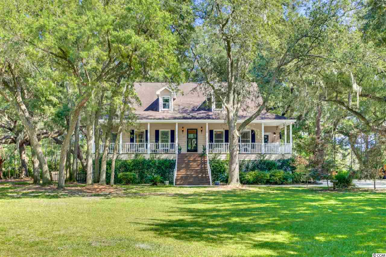 Beautiful raised home with over 3 acres of land! Located in Wedgefield Plantation, You'll have the best of both worlds being in a golf course community and living on the water. This home is a MUST SEE!! Call today with any questions or to schedule a showing!