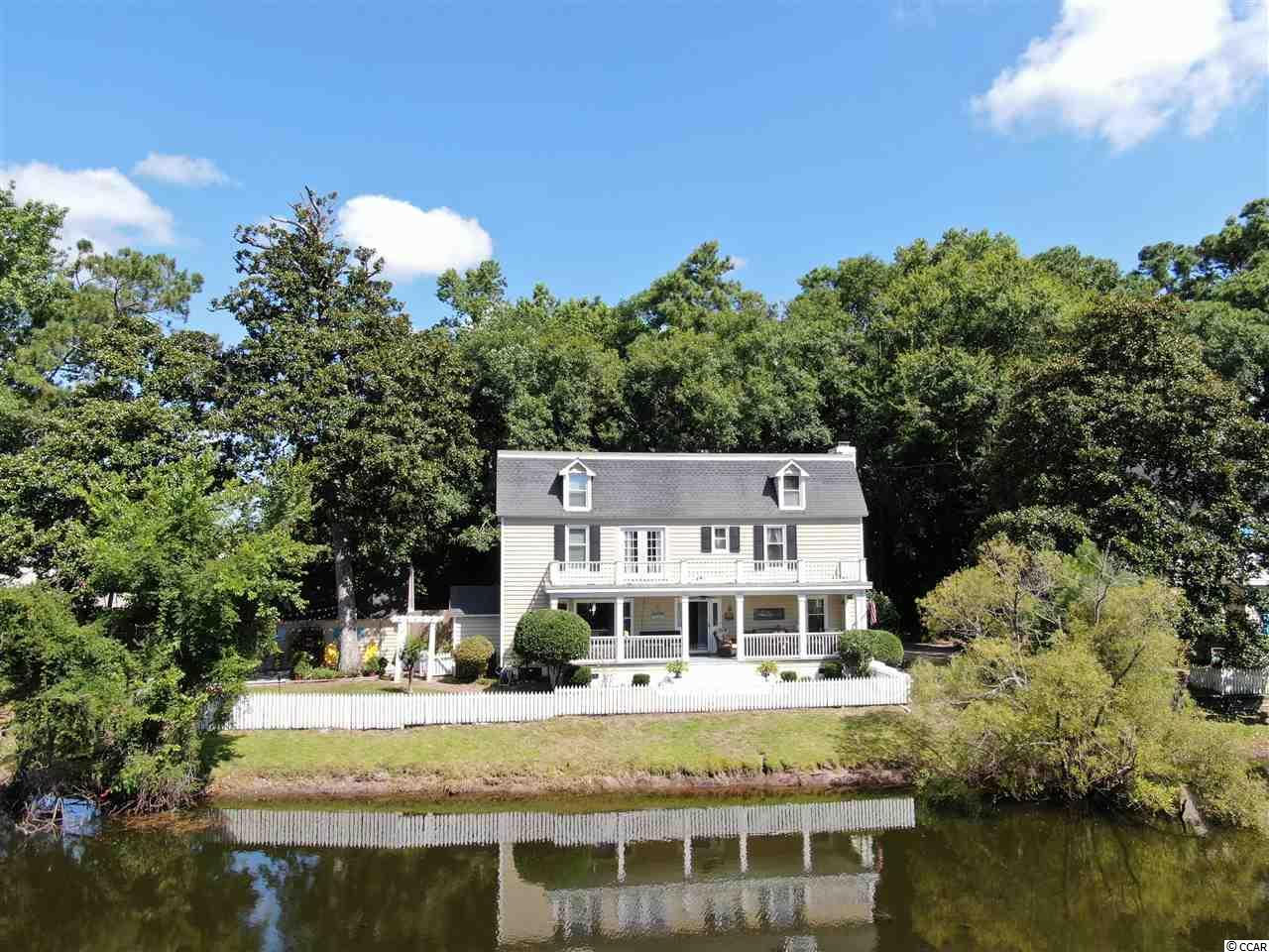"""Incredible opportunity to reside in one of the most popular communities in Murrells Inlet! If you don't know about Mt Gilead.. you need to ! Oozing with charm and an abundance of lake frontage, this unique abode has it all. 735 Mallard Pond road hugs the lake and is situated at the end of a dead end road offering immense privacy and no through-traffic. Features / Upgrades include over 3,000 square feet of living space, a detached garage ( that could also be used as a work shop ), a multi-level guest suite with office ( Could also be used as a 4th bedroom, hardwood flooring, ships lap accents, and so much more.  Whether you are relaxing on the porch with your mimosa or manicuring your waterfront garden.. you will undoubtedly be referring to your new home as 'Paradise """" ."""