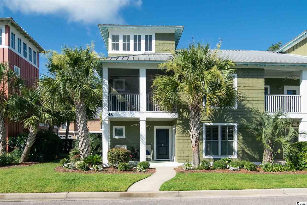 Welcome to MINGO - a secluded community that is close to everything Litchfield Beach has to offer!  This neighborhood features a beautiful swimming pool and club house.  Bike paths all around that span from Pawleys Island to Huntington State Park and onto Murrells Inlet Marsh. This like-new home is filled with all of the upgrades available: Beautiful heart pine floors, granite countertops, stainless steel appliances, gas fireplace, finished loft, plantation shutters, elevator and 2-car garage.  Home overlooks a lovely pond with a fountain. Steps or golf cart ride away from gourmet bakery and wine shop, salon, spa and public library and grocery store. Mingo is an ideal neighborhood for anyone looking to enjoy the relaxed Pawleys Island lifestyle.