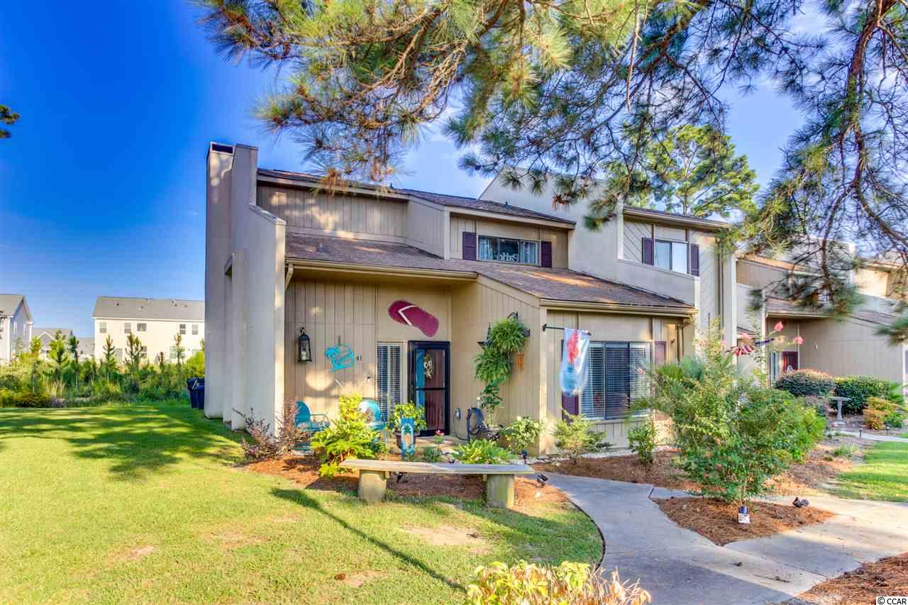Back On the Market!!! Baytree I 3BR/3BA End Unit Townhome. This condo has many upgrades:  appliances, granite counter tops, beautiful wood accent walls/ceilings, new concrete patio & more!  A must see!  Furnishings sold separately. Close to fine dining, shopping, medical facilities & just a short drive to the beach!