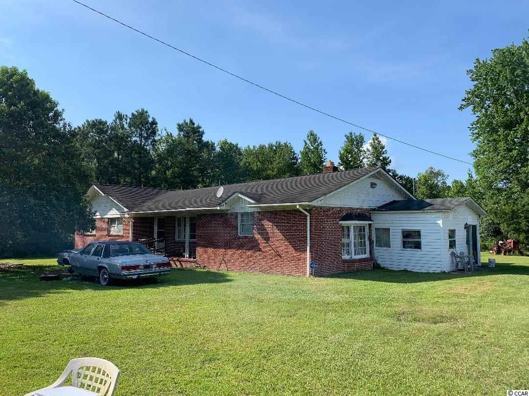 Brick home nestled on 7+/- beautiful acres.  Lots of room on the property.  Super space for expansion of the home and other buildings can be added.  You will have room to spread out and create an area of peace and relaxation.