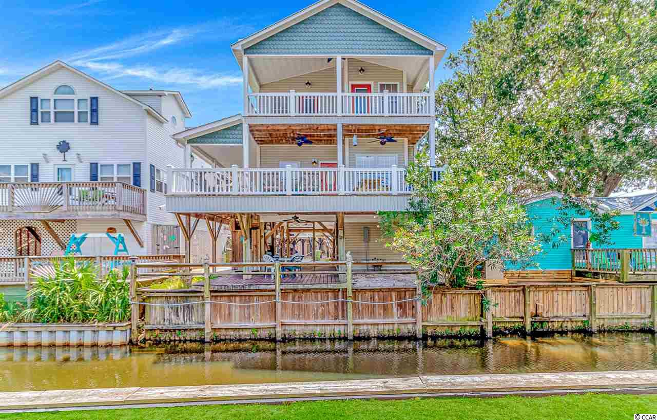 Prime location in Ocean Lakes located just steps away from the beach. This home is located on a canal and offers an Ocean view. Enjoy the decks on both levels and the outdoor space. You are sure to enjoy the space in this 5 bedroom 3.5 bath home. Beautifully furnished with all furnishings updated in 2019.  Ocean Lakes offers 24 hour security and many amenities such as indoor and outdoor pools, waterpark with a splash zone, lazy river and slides, basketball courts, volleyball and much more. All measurements and square footage are approximate and not guaranteed. Buyer is responsible for verification.