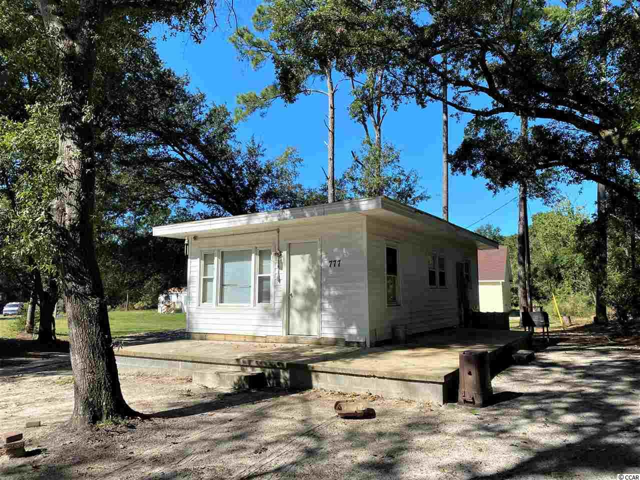 Great INVESTMENT or GET-A-WAY property that sits on .41 acre of land surrounded by beautiful tall oak trees in Little River, just minutes from Cherry Grove Beach. This unique one bedroom, one bath house has great potential. A MUST see!