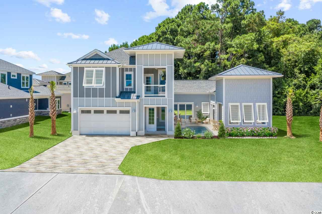 """BRAND NEW 4BR/3.5BA LUXURY INTRACOASTAL WATERWAY VIEW SPEC HOME WITH A CUSTOM SWIMMING POOL AND A MAGNIFICENT OBSERVATION TOWER OVERLOOKING THE ICW IS NOW AVAILABLE! Do you want a truly unique design that has never been offered to anyone in our area that offers a large Master Suite on the first floor? Have you dreamed of living along the ICW but never thought you could afford it? Do you have thoughts of owning a boat and keeping it in your own private wet slip in your backyard? Have you always wanted your own custom swimming pool with a beautiful brick pavers pool deck? If you answered YES to the questions above, do yourself a favor and call me before you read any further. Don't lose out on this incredible new construction opportunity! The """"Birds of Paradise"""" Plan has it all and it is unique! As you pull into the gates of this waterfront community and see this custom home you quickly realize this place is special! Its lush tropical landscaping and stone privacy wall gives you a hint that this home is much different than all the others. As you walk through the front door, you witness the porcelain tile floors, 10' ceilings and a custom trim & crown molding package that is second to none! You continue to walk thru the Gallery and you notice your spouse and your family begins to smile as they love the (3) 12' stackable sliding glass doors that open from the dining room, the great room and the master bedroom into the front courtyard that host a custom swimming pool with a beautiful brick pavers pool deck. After spending a few minutes poolside, you walk back into this wide open floor plan and into the spacious kitchen with stainless steel appliances, upgraded cabinetry, beautiful granite counter tops and an elegant 8' kitchen island. Amazed, you continue to the Great Room and notice the double tray rope lighted ceilings. This home has incredible details! You want to see the Master Suite and quickly notice it is incredibly spacious and has a large walk in closet with cust"""