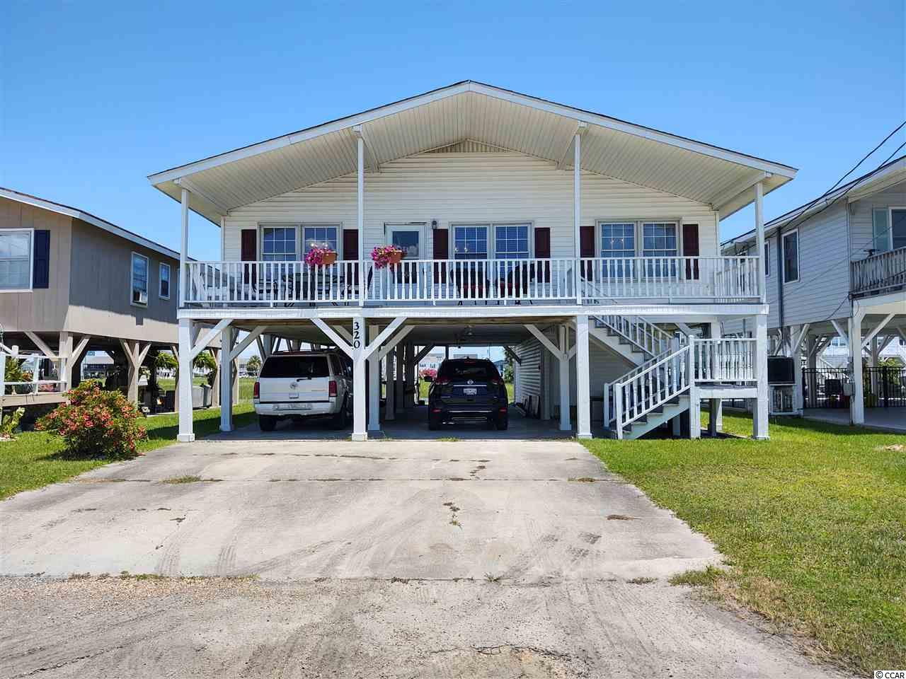 Very desirable 4 bedroom, 2 and one half bath house on the channel in Cherry Grove.  Features a Carolina Room with unlimited views of the marsh.   New roof in 2018. Sold furnished minus a few items. All new appliance, except the microwave which is approximately 2 years old.  The washer and dryer are two years old.  Vinyl flooring is all new. In great condition.  The back porch overlooks breathtaking views of the Cherry Grove marsh. Wonderful area downstairs for storage and workshop. Square footage is approximate and not guaranteed. Buyers responsible for verification.