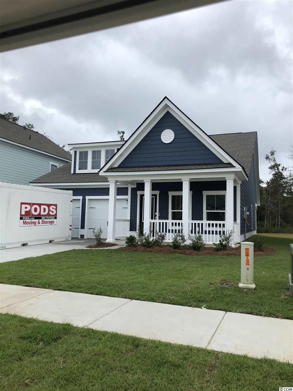 """Exciting Phase 3 and 4 homes underway! You cannot beat this location!  Just a five minute drive to the beaches. Close enough you can even walk or ride the golf cart. This Home is a DEAL. Get in Early for Preconstruction Prices. Call Gregg Weissman  for more information and get the New E-Flyer. Featured home is The Annandale Model with the bonus room. Lennar is Very Excited to celebrate the PHASE III and IV GRAND OPENING of this highly anticipated Market Common New Home Community. (Belle Harbor) Our Welcome Home Center is open at  Belle Harbor.  This home boasts southern charm. Check out our new floor plans. Come sit and relax on the big front porch and enjoy our resort style amenities!  Belle Harbor (A Coastal Lifestyle Community) is nestled in the pristine Community of Market Commons. It will feature 400 beautiful homesites backing up to woods and pond views. With a selection of homes ranging from 1772 to 2899 heated square feet, they're flexible enough to meet any family's needs. These homes will feature our """"Everything's Included"""" package which includes many upgrades such as HardiPlank® siding, granite countertops, tiled backsplash, Frigidaire stainless steel kitchen appliances and upgraded cabinets in the kitchen. Tile flooring in baths / laundry room and a tankless water heater (Rinnai). Also includes a gas range, 2 car garage and a covered lanai for outdoor living enjoyment. There is so much to discover in this diverse and intriguing area. (1.5 miles to the beach). Short Golf Cart ride to shopping, restaurants, and the beach.  We invite you to surround yourself with natural beauty and find how living the Belle Harbor lifestyle may be perfect for you..**Photos are of similar home in another community. Buyer responsible for verification of all measurements."""