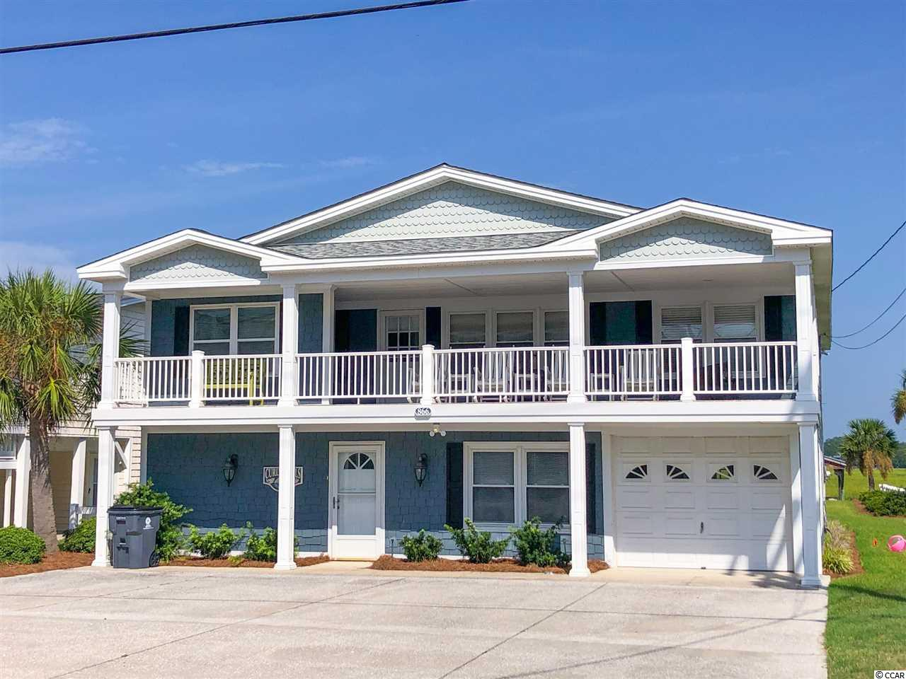 866 South Waccamaw is a bright and happy beach house located eight blocks south of the Garden City Pier. Ocean views can be seen from the front porch and many of the front windows. The back of the house is on the inlet, complete with a dock and boat lift. It is the best of both worlds, filled with views, views, and more views! Inside, enjoy a traditional Carolina beach home floorpan. The center of the house is devoted to enjoying family, while both sides contain the bedrooms and bathrooms. Upstairs there are four bedrooms and three bathrooms. The ground floor offers a large, enclosed area with laundry, entertaining, storage and two bedrooms and a bathroom.