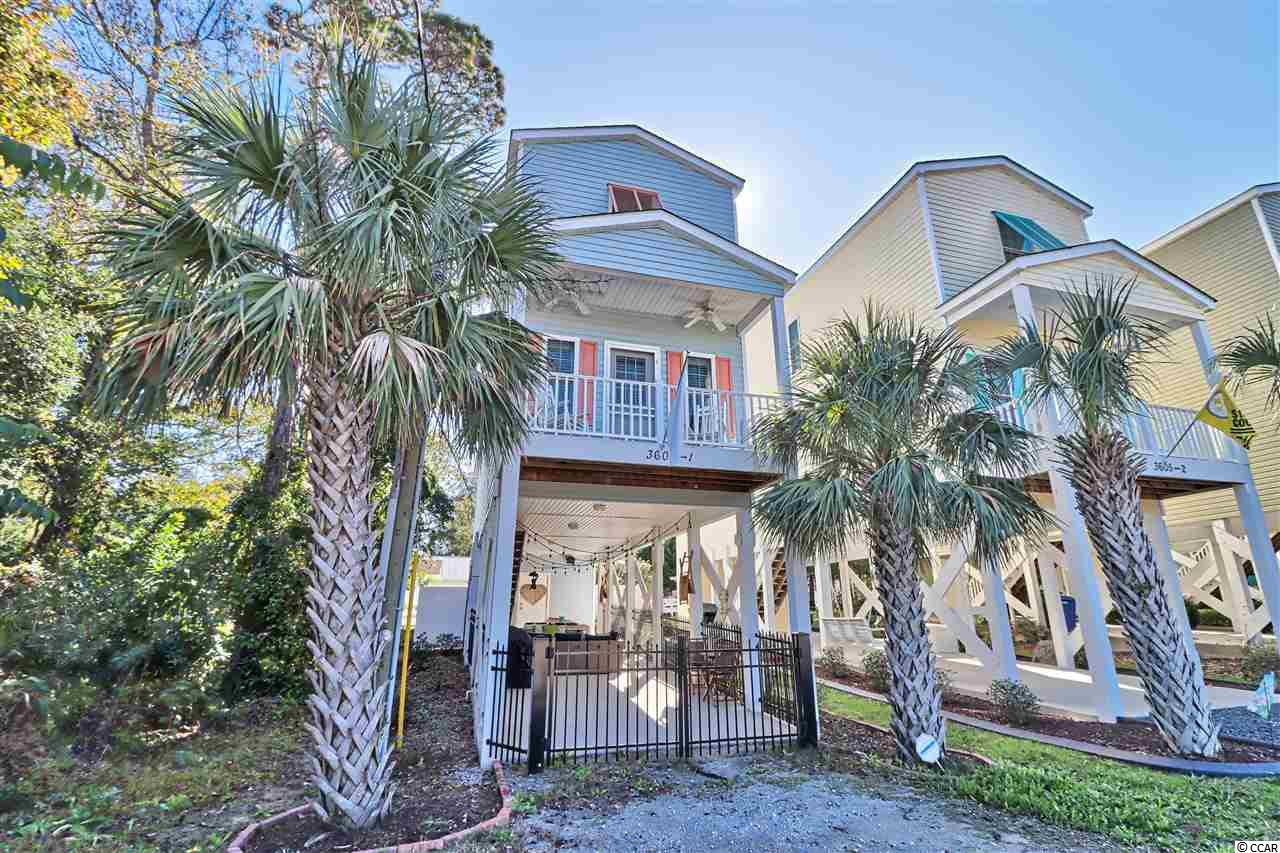 """Open House!  Saturday, August 15th 2:30 - 5:00 p.m. Stunning 3 bedroom, 2 bathroom raised beach style home available just a short golf cart ride to the beach! When you walk into the main living space, you will appreciate the luxury vinyl plank flooring, neutral paint throughout, recessed lighting and crown molding. Off of the main living area you will find a 14x4 balcony, with ceiling fan - perfect for a morning cup of coffee or enjoying a good book. Kitchen showcases bright 42"""" white cabinets, stainless steel appliances, granite counters, and a breakfast bar. The master bedroom is located on the 1st level of the home, and features a jack-and-jill style bathroom connecting to the hallway. On the 2nd level, you will find 2 additional guest bedrooms and an updated bathroom. Guest bedrooms feature carpeting, ceiling fans, and crown molding. There is also plenty of room for entertainment on the ground level, which is open with recessed lighting and fencing surrounding the lot. The ground level also has a 14x6 attached storage area. This home has NO HOA, which means no restrictions! This would make a perfect primary residence, 2nd home, or investment property. Just a short trip to the beach, and close to shopping, dining, and entertainment. Measurements are not guaranteed and are the buyers responsibility to verify."""