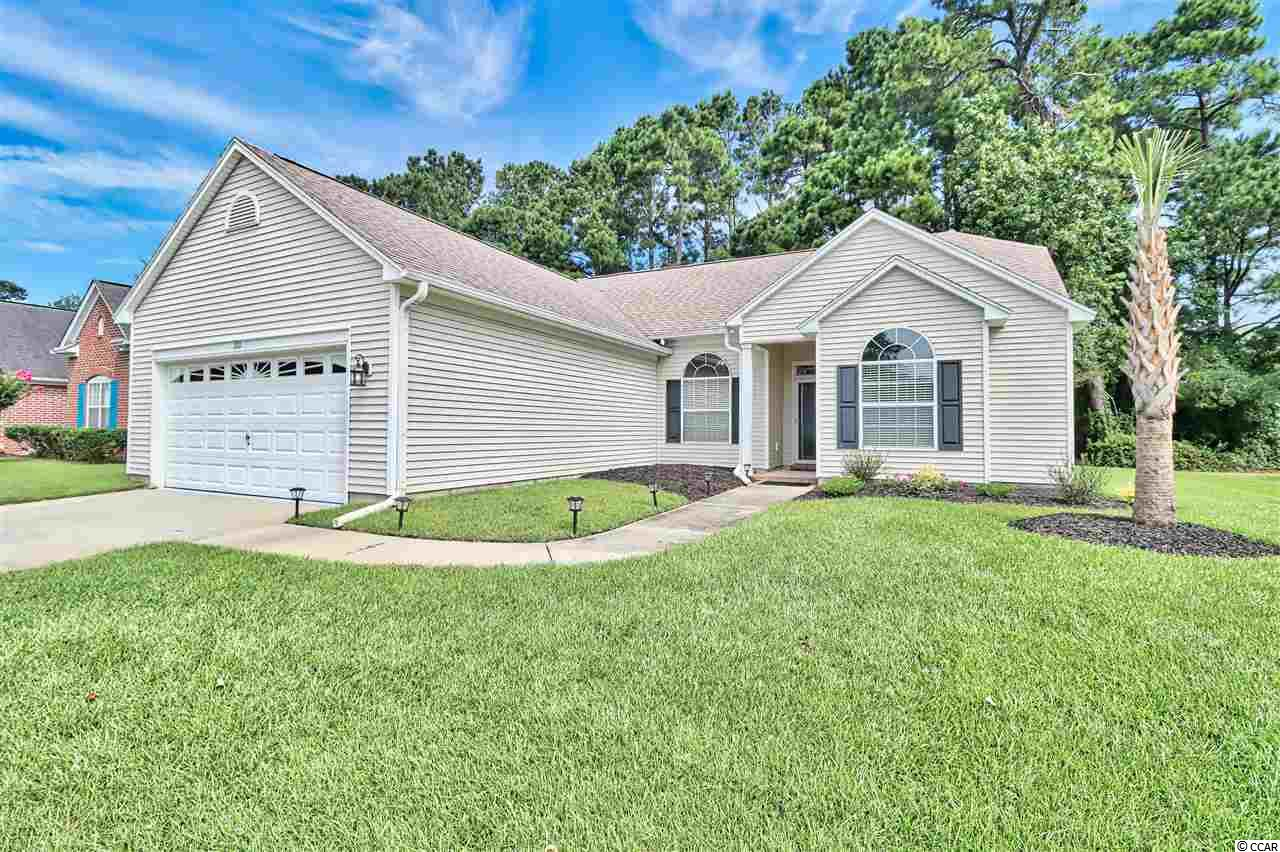 Welcome to The Tradition, a desirable neighborhood located in the seaside community of Pawleys Island. Backing up to the 7th fairway and situated on a quiet cul-de-sac, this FULLY FURNISHED 3 bedroom 2 bath home received a major renovation in the fall of 2019.  The custom cabinetry and granite countertops of the updated kitchen accent a large island with a built-in single basin sink and all new stainless steel LG appliances.  The main living area boasts cathedral ceilings that open up into the sunny Carolina room, overlooking your private backyard and patio.  With beautiful hardwood flooring that continues into the bedrooms, a large walk-in closet, tray ceiling, and tiled shower are the perfect finishes in the master suite.  The two additional bedrooms share a remodeled guest bathroom in this split level design.  Just unpack your bags and relax in your new home at 101 Cobblestone Drive. Residents enjoy numerous amenities including a neighborhood pool, tennis courts, the option to join The Tradition Golf Club, as well as Litchfield by the Sea privileges. LBTS gives owners private beach access with parking, a large oceanfront sun deck, restrooms, showers, lighted tennis courts, crab dock, fishing docks, and plenty of walking and biking trails.