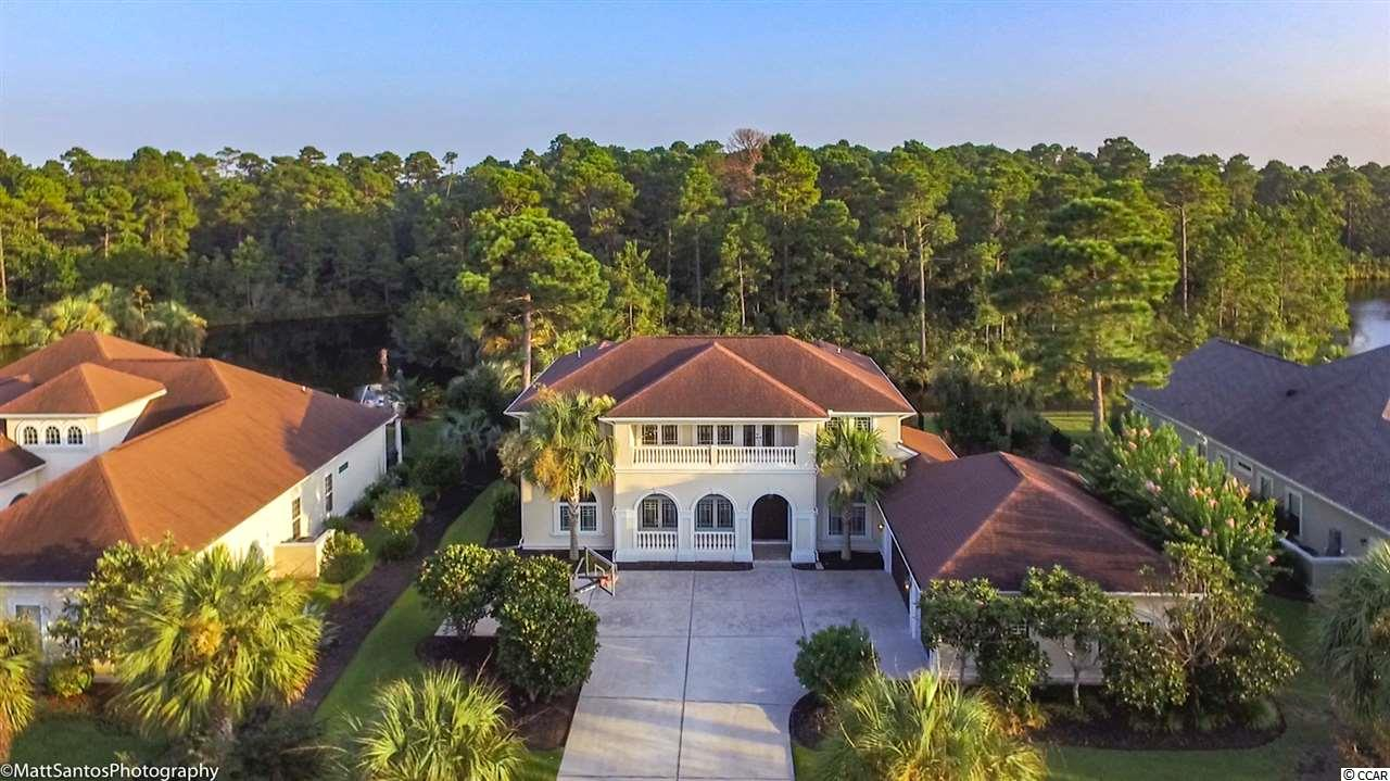 """WELCOME HOME!!! THIS GORGEOUS, MEDITERRANEAN LAKEFRONT HOME IS LOCATED IN THE EXCLUSIVE PLANTATION LAKES NEIGHBORHOOD WITH-IN CAROLINA FOREST. THIS HOME WILL TAKE YOUR BREATH AWAY FROM THE TIME YOU WALK THROUGH THE BEAUTIFUL, CUSTOM BUILT FRONT DOORS!! ENJOY HOLIDAY DINNERS IN YOUR NEW, LARGE FORMAL DINING ROOM! """"COOKING THERAPY"""" WILL TAKE ON A WHOLE NEW MEANING IN YOUR NEW DREAM KITCHEN, THAT BOASTS GRANITE COUNTER TOPS, STAINLESS STEEL APPLIANCES, AND A GAS RANGE WITH HOOD!! THIS HOME HAS ALL THE BELLS AND WHISTLES, INCLUDING A LAKEFRONT CAROLINA ROOM WITH A SEE-THROUGH FIREPLACE THAT LOOKS INTO THE 2-STORY LIVING ROOM!! THIS HOME HAS A SPLIT BEDROOM PLAN WITH THE LARGE MASTER BEDROOM AND SITTING AREA ON THE FIRST FLOOR. WAIT TIL YOU SEE THE MASTER BATHROOM!!! MAKE YOUR WAY UPSTAIRS TO THE OPEN LOFT/ GAME ROOM THAT INCLUDES AN OUTSIDE BALCONY THAT OVERLOOKS THE LARGEST LAKE  SECTION IN THE NEIGHBORHOOD!! YOU WILL BE OVERLY IMPRESSED WITH THE SIZES OF THE 4 UPSTAIRS BEDROOMS, WHICH INCLUDE JACK AND JILL BATHROOMS, LOCATED OFF OF THE LOFT/GAME ROOM.  THIS HOME INCLUDES A BUILT-IN BOAT DOCK, FENCED-IN BACKYARD, BEAUTIFUL OUTDOOR PATIO WITH A PERGOLA THAT OVERLOOKS THE LAKE!! THIS HOME HAS MASSIVE AMOUNTS OF STORAGE, ALONG WITH A HUGE, OVER SIZED, 3 CAR GARAGE!! SO LET ME BE THE FIRST TO WELCOME YOU HOME!!  KICK OFF YOUR SHOES, FIRE UP THE GRILL, ENJOY A SUNSET BOAT RIDE, AND LOVE WHERE YOUR LIVE....THIS HOME WILL MAKE THAT EASY!!!"""
