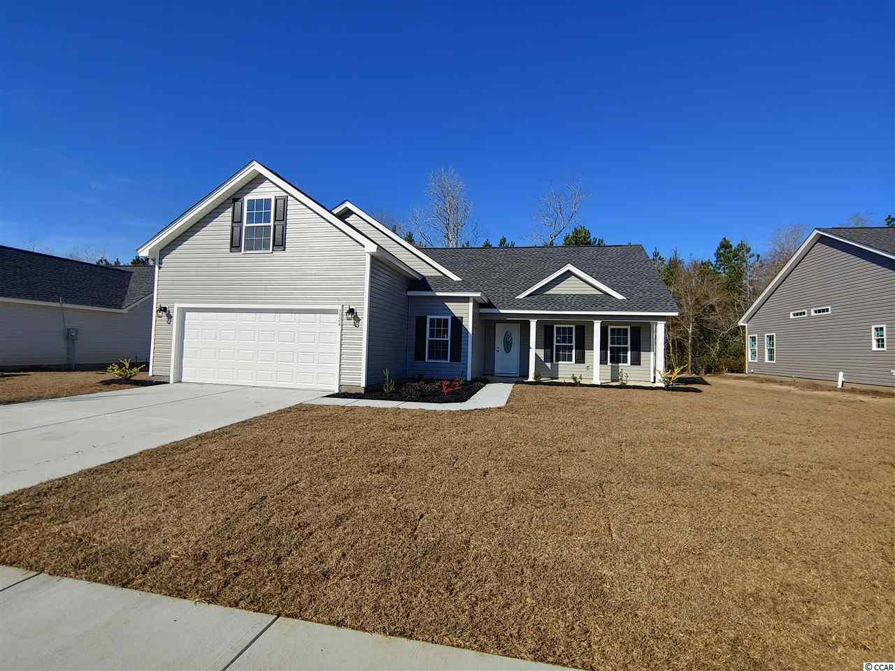 """Beautiful Dogwood Plan in The New Woodland Lakes Community in The City of Conway, SC. Woodland Lakes is a Natural Gas Community located in Conway, South Conway just minutes to Historical Downtown Conway, Coastal Carolina University, and Conway Medical Center. Plan offers all of the right features and benefits.  Features include but are not limited to 3 Bedrooms 2 Baths, Large 2 Car Garage, Great Open Floor Plan, Vaulted and Trayed Ceilings, 2 Ceiling Fans, Plant Shelf, and Vinyl Windows, Plans also include Separate 10x14 Concrete Patio,Screened Rear Porch, Covered Front Porch,  Sidewalks to Front Entry and Driveway, Granite Counter Tops in Kitchen, 2 Sinks in the Master. All of the Homes in Woodland Lakes Community come standard with the luxury of a Tankless Hot Water Heater, Gas Heat, Gas Stove and Oven. These new Homes also include 36"""" Profiled Kitchen Cabinets with Top Molding Trim and Door Knobs, Stainless Steel Appliances, Kitchen Pantry, Linen Closet, Completely Trimmed and Painted Garage with Drop Down Storage Access, which is Floored for your convenience, and Electronic Garage Door with Remote Openers. """"Low E"""" Energy Efficient Windows, Upgraded Insulation Package, Landscaped, Sodded Yard, and so much more.  All of the homes in Woodland Lakes are built with a """"Maintenance Free"""" Lifestyle in mind. Woodland Lakes is South Conway's Newest Community conveniently located near Shopping, Medical Offices and Hospitals, Restaurants,  and Schools. The Builder DOES ALLOW CUSTOM HOME CHANGES!  Call or visit us online today and find out why This Builder is The Areas Premier Local Builder! Other Floor Plans, Inventory Homes and Custom Plans are Available. Call the Onsite Model for New Homes Availability and to make an Appointment to see Woodland Lakes."""
