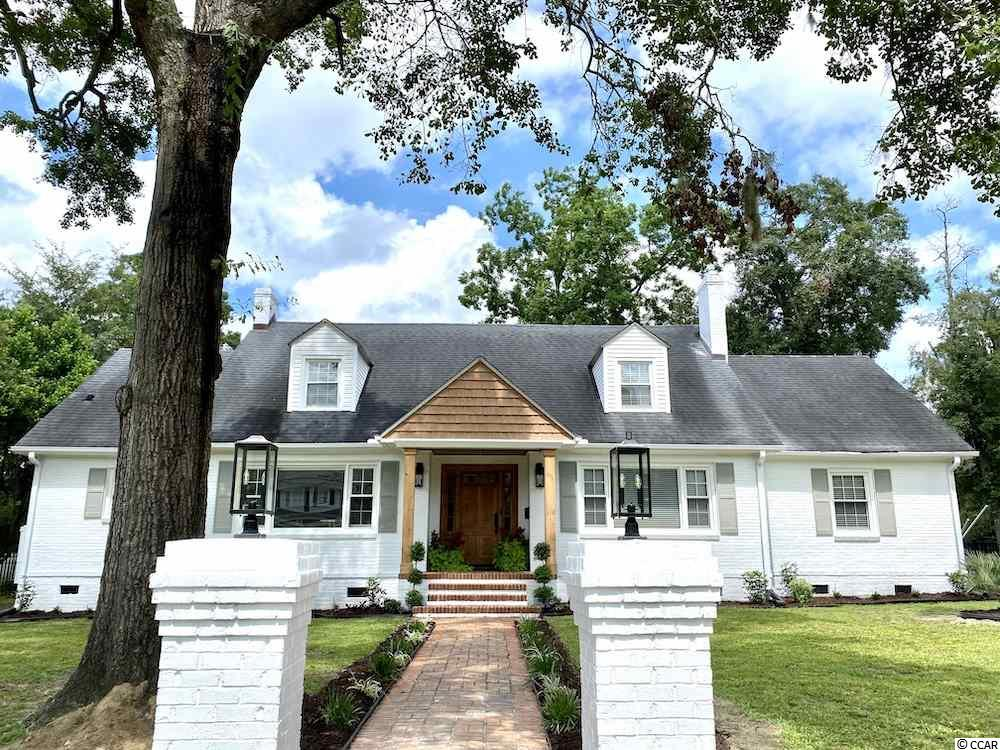 """Looking for a classic historic home nestled on a street framed by timeless Oaks AND all the updated design, bells & whistles you can imagine!? This 3,776 sq foot home sits comfortably on a .43 Acre corner lot in downtown historic Conway, SC. 700 Elm boasts of 5 bedrooms (Master + Guest on first floor with 3 large bedrooms on second level), 2.5 bathrooms, a formal dining, flex room/office, plus an extra large 2 car detached garage (complete with storage above), and a attached 2 car carport & a fenced yard! This home has been completely renovated including electrical, plumbing, hvac, ductwork, sanitized ductwork, a huge chef's kitchen, quartz countertops, new cabinets, all new appliances including 36"""" gas range, landscaped yard, beautiful hardwood flooring throughout, fresh exterior paint, coffered portico ceiling and so much more - they thought of it all!!"""