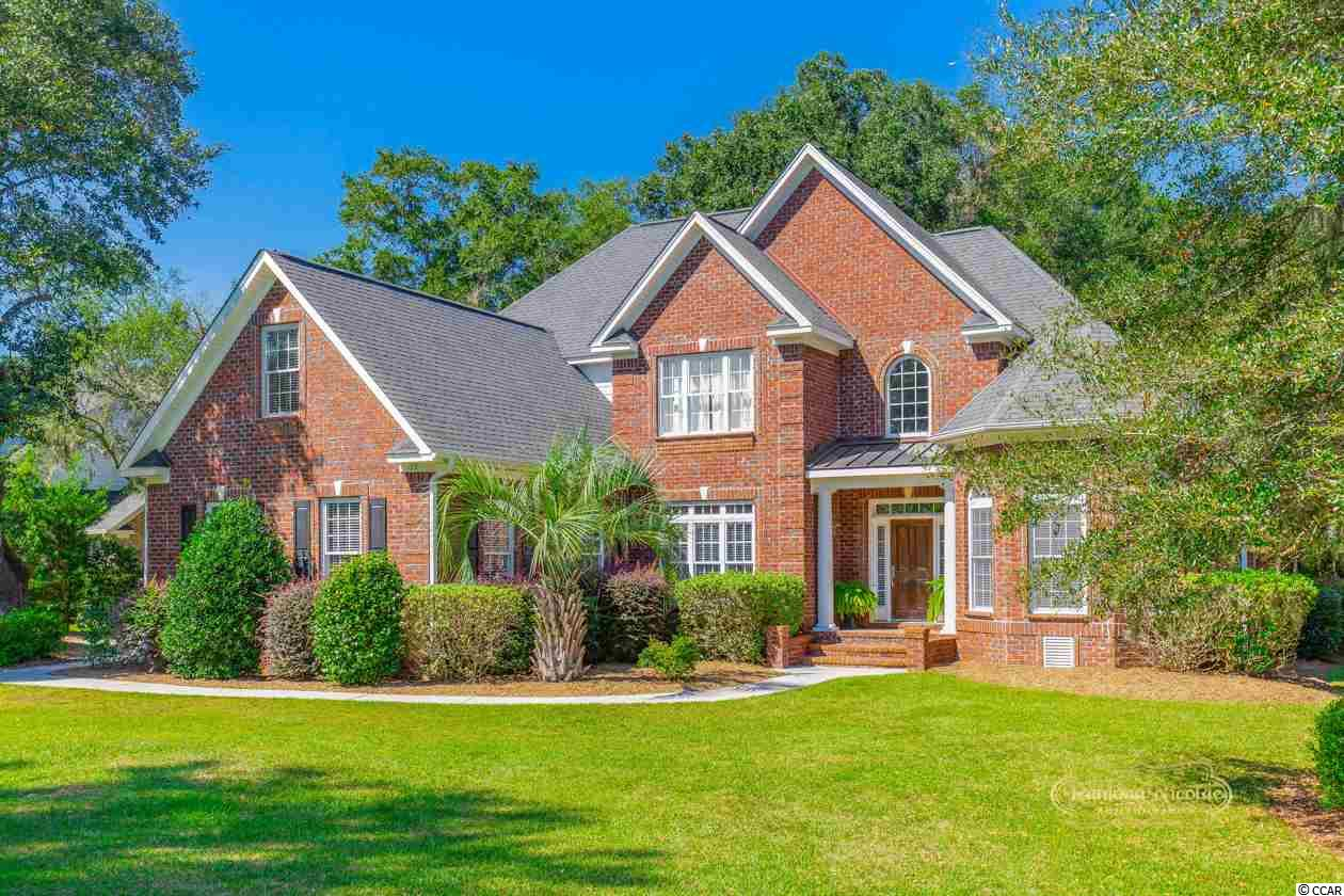 This home with, 3 fireplaces, two indoor and one out door,  is located in a gated Golf community which backs up to the old Ricefields with views of the marshlands to the Waccamaw River. The  home has a very open Floor plan with great views throughout and flows nicely between the great room, dining room, kitchen, etc.  There are fireplaces in the both the living and family rooms, as well as the beautiful all brick fireplace located on the patio in the back yard. The spacious Master Bedroom is located on the first floor level and has access to the Master Deck in the back yard. The Master Bathroom features double vanities, a large garden tube, and a walk in tile shower.  Willbrook Plantation winds Thru marshes and wetlands providing excellent habitat for all kinds of nature. The community golf course is second to none. In addition to the amenities available at WillBrook Plantation, you will have access to Private ocean access thru Litchfield by the sea plus all those amenities tennis, clubhouse, fishing and crabbing dock, and best of all, Private Ocean to the pristine white sandy beaches with ample parking, oceanfront clubhouse, deck, restrooms, outdoor showers and more. Just minutes to Huntington Beach State Park and the famous Brookgreen Gardens, Murrells Inlet Waterfront Marsh walk and Charleston is also close by. Let the shabby Elegantly luxury of Pawleys Island and the laid-back, Low-Country lifestyle reel you in