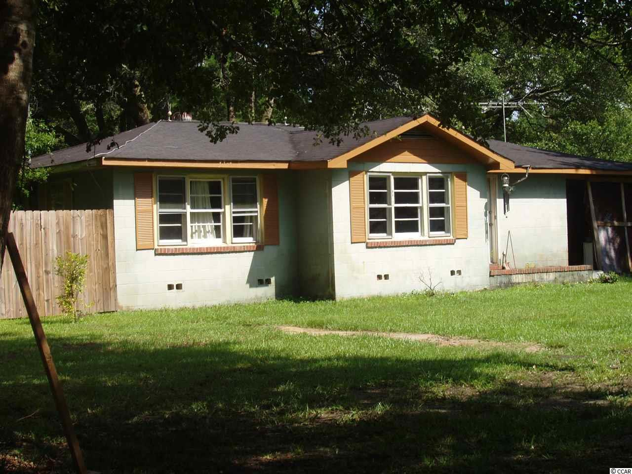 "4.5 acres in a lovely, quiet, country setting. Fixer upper cinderblock house. Has heat but no cooling system. INTERIOR PICTURES ARE OF THE SINGLE WIDE MOBILE HOME with two bedrooms and one bathroom ON THE PROPERTY, which is in good condition. Also a small vintage house from around 1920 that needs work with approximately 400 square feet. Animal lovers dream. Chicken coop and small fenced in area for other animals. Two storage buildings on the property. Blueberry and fig bushes. Selling ""as-is"". Public water and sewer. Updated plumbing. Driveway regraveled. RV parking. Buyer responsible for verification of square footage of land and buildings."