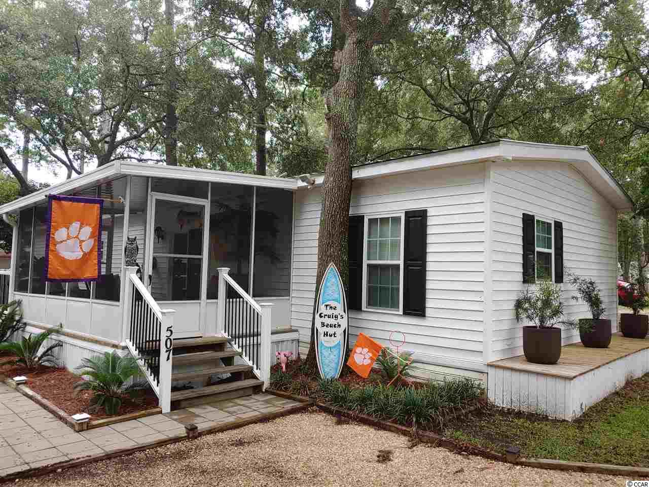 Come see your next home away from home. Conveniently located with just a short walk or golf cart ride away from Garden City pier and beach. This updated beauty has plenty of room for you and your guests, with storage included! Outdoors there is a stone walkway that leads from the exterior built-i in shower to the screened in front porch. There's even an awning/carport to park your golf cart! You'll find a large shed out back and a huge storage closet inside. Two additional parking spaces are located out front! All appliances come with this home! The layout has been widened for more space than you typically find in this style of home. It is available furnished so if you want move in ready with beach access why not make this yours today! (Motorcycles and pets allowed. Boat is allowed if it fits under carport.