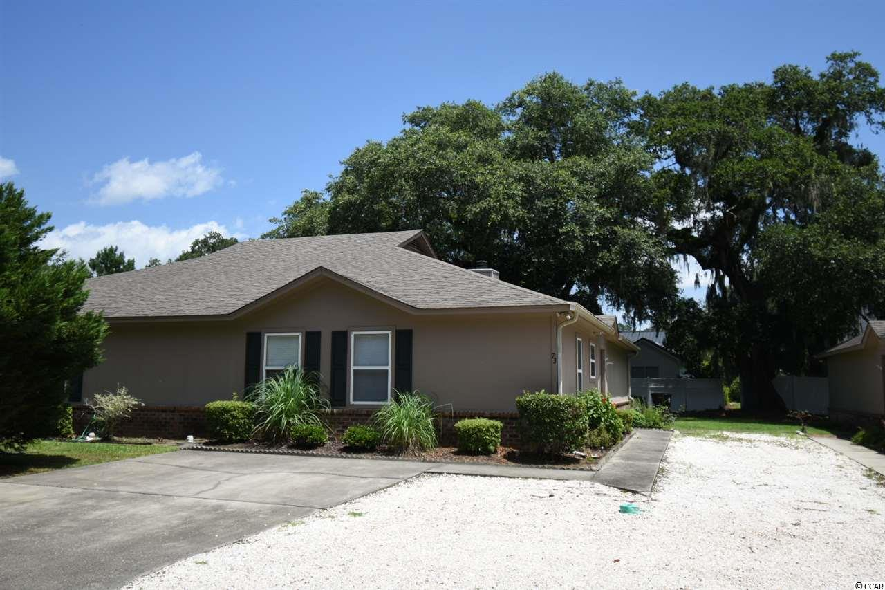 Located in the beautiful Wedgefield Plantation is this meticulously maintained  bedroom, 2 bathroom single story townhouse.  There have been many recent upgrades including the AC and all new low maintenance LVP flooring.  This is a very spacious townhouse and because it is all on one floor, it feels much more like a house than a townhome.  There is a large screened back porch and a patio behind the home and it is located on a dead-end street.