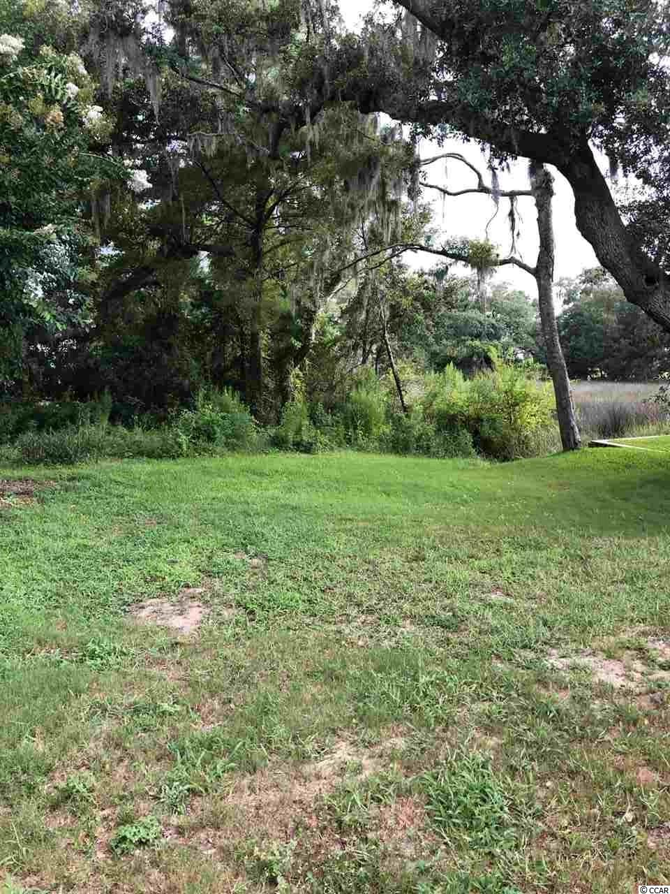 Builders and those of you searching to build with a view of the water and a lot previously approved for crabbing dock permit. Look at this highly desirable lot with a view. Lot boundaries extend into the marsh. Drop by and get out of your vehicle and walk toward the center of the lot and look back at the view toward the water. Don't let this attractively priced lot pass you by.