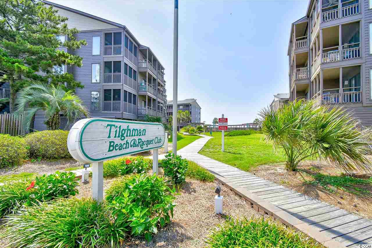 Welcome home to this fully furnished 3 bedroom, 2.5 bathroom condo in Tilghman Beach & Racquet Club. This unit on the 2nd floor includes beautifully coordinated furnishings throughout, wood laminate flooring, crown molding, and a view of the ocean from your screened in balcony. The kitchen is equipped with all appliances, white cabinets, and a unique back splash. An open floor plan of the main living areas makes quality time and entertaining a breeze. Each bedroom features a ceiling fan, plenty of closet space, and easy access to a bathroom. The master includes these features, as well as a sliding glass door to the balcony, and a walk in shower. A washer and dryer is included with sale for added convenience. Tilghman Beach & Racquet Club offers a community pool, hot tub, tennis courts, a grilling area, and is perfectly situated near all of the Grand Strand's finest dining, shopping, golf, and entertainment attractions, with just a few steps downstairs to the ocean! Whether you are looking for an investment opportunity, 2nd home at the beach, or your forever home, you won't want to miss this. Schedule your showing today!