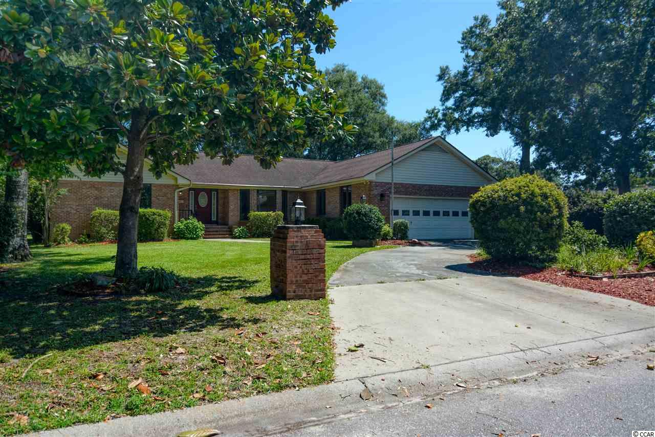 3bed/2ba SINGLE STORY, All Brick home is located EAST of 17 in a neighborhood! Large Private Lot and 2 car garage includes a ramp into the house so it's HANDICAP READY, if needed. Easily Walk through this Quiet Neighborhood straight to THE BEACH or stop and enjoy the lake and dock on the way. Or get on your bike or golf cart and enjoy shopping and restaurants nearby.  Large open floor plan and tons of windows make this house feel light and bright. The split floor plan is perfect for families or guests. Enjoy the private and lush tree-lined backyard from the spacious deck, which you can access from both the living room AND Family Room/Carolina Room.