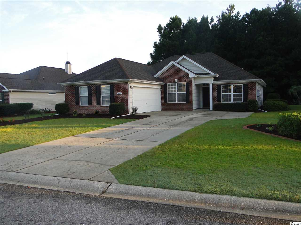 Don't miss out on this great home in the Links section of the International Club. This home features three bedrooms plus a bonus/office. Freshly painted with beautiful hardwood oak flooring. New landscaping recently installed with low maintenance brick and vinyl exterior. Only minutes from the beach, shopping, and all the Grand Strand has to offer. Hurry up and schedule a showing today. This one won't last long at this price!