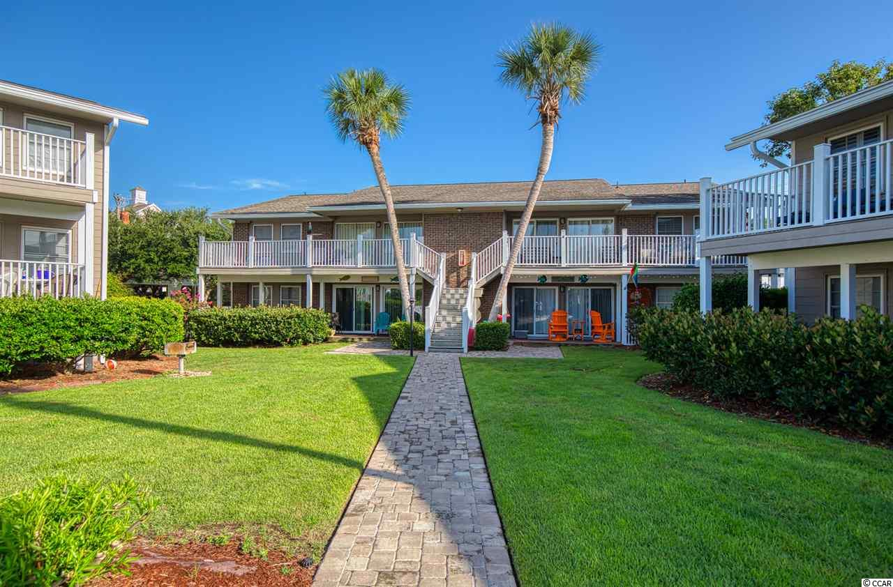 This FIRST FLOOR, fully furnished condo at Floral Villas is located in one of the most unique condo communities on the Grand Strand. This 3BR, 2BA, Second Row Beach condo has had several recent upgrades including a new HVAC system in 2016, the water heater and electric panel was updated in 2017, a new refrigerator 2017, and a new range 2019. When you step out of the living room onto the back porch, you will see a gorgeous courtyard with lush landscaping that surrounds the community swimming pool (8 feet deep). The master bedroom has access to the porch as well as an ensuite bathroom. The spacious guest rooms each have a walk-in closet and let in plenty of natural light. There is also a washer and dryer in the unit. With only 20 units in the entire complex, each of the 5 buildings consist of four units with each having a large patio or back porch area as well as a storage room. There are also two beach accesses within walking distance from the condo. Schedule your showing today!