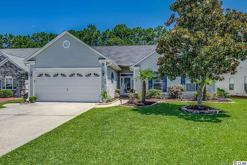 Welcome to 1468 Sedgefield in the beautiful Murrells Inlet community of Indigo Creek, where the landscaping is lush and mature adding so much appeal for most buyers. This home is stunning and very much in vogue with the hardwood flooring, sliding barn doors and incredible his/her home office that was once a Carolina Room.  Roof was replaced in 2016 and the HVAC replaced in 2014. All of the living areas offer hardwood flooring and/or luxury vinyl plank. This unique home offers plenty of living space between the 22x14 living room and the 20x12 Great Room. Open your sliding barn doors to a spacious 15x13 home office with lots of natural light, luxury plank flooring, gorgeous Palladium window overlooking the wooded setting in your backyard. Working from home has never looked so good. The Family Room is complete with a wood burning fireplace crowned in stacked stone, slate mantle and accent lights. The spacious kitchen offers tile floors, stainless appliances, back splash, double ovens, microwave, dishwasher and disposal. Laundry room is located off of the kitchen and features a sliding barn door entry and tile floors. The bedrooms are located to the right of the front foyer with a hardwood hallway. Master Bedroom features vaulted ceilings, hardwoods and ceiling fan along with a walk-in closet and an additional closet. Master Bath offers a double vanity, jacuzzi whirlpool tub and separate shower. The other two bedrooms are carpeted and offer ceiling fans and closets. There is an irrigation system in front, back and both sides of the property. Two car garage offers a utility sink. The outdoor living space in the yard is very private and the perfect place to unwind and entertain. Swing set and trampoline can be removed by Seller.  Indigo Creek is a very active community with fun activities buyers may choose to participate in planned by the HOA along with a pretty community pool and clubhouse. Golfing, shopping, walking, biking it's all here for you and the beach is a short