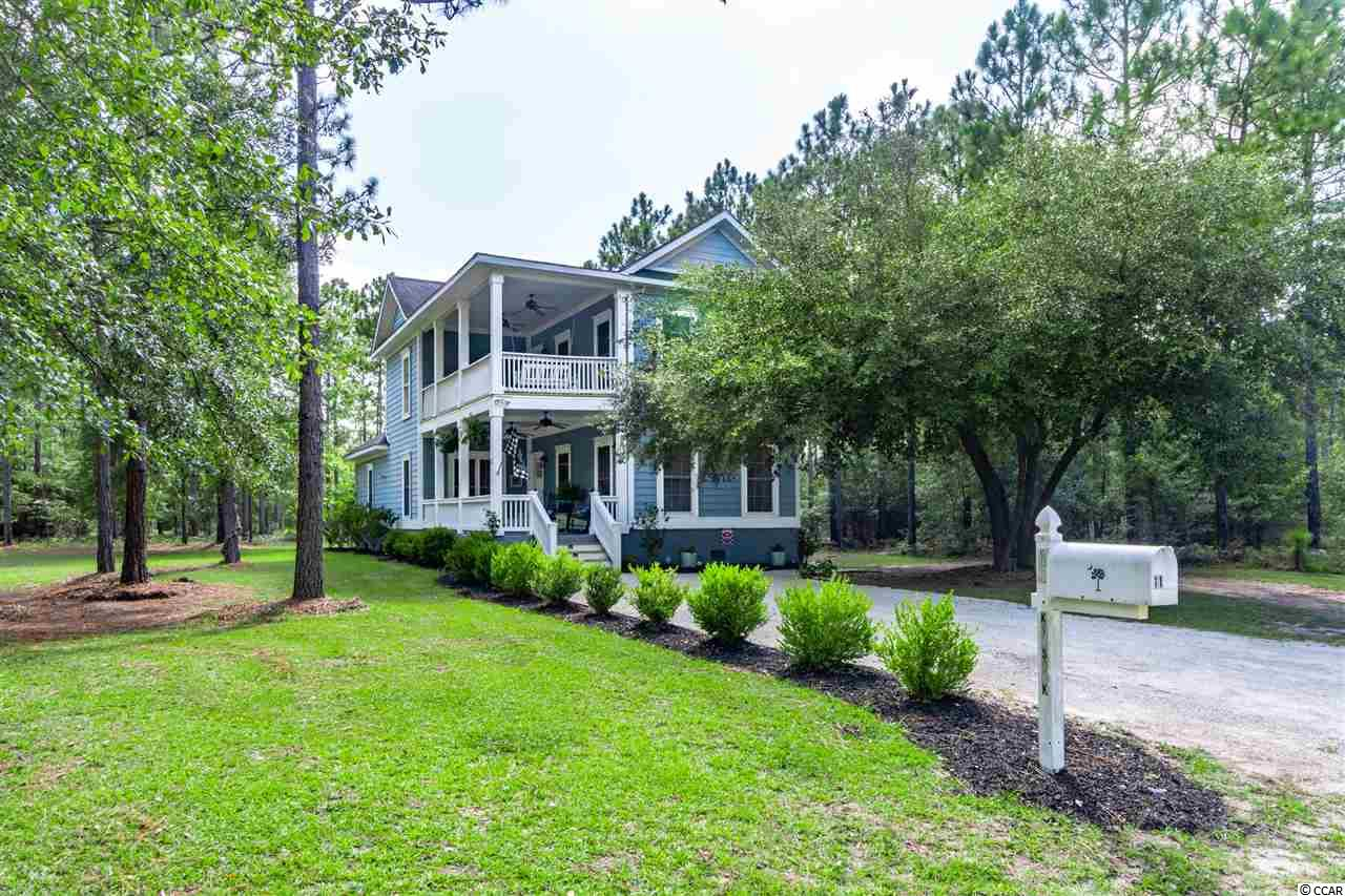 Gorgeous Charleston Style Home located in Harmony Township - 11 Kilsock Drive!  Harmony Township is located in historic Georgetown, South Carolina and sits on the banks of Sampit River, flanked by timeless live oaks, native wildlife and wide open spaces. The welcoming porches beckon you to sit, enjoy and rock awhile with a good book and some sweet tea - you'll see what I mean!  This is a great floor plan with a comfortable flow - attractive crown molding, smooth ceilings, lots of windows and so much charm.  The great room has a cozy gas heat fireplace, wide plank pine floors and is the perfect spot to unwind.  The kitchen is very spacious with more than ample cabinetry, pantry, stainless appliances, large breakfast bar and nook seating area adjacent to the formal dining space.  This is a wonderful gathering spot for entertaining during holiday time, or well, anytime for that matter.  The cheery owner's suite is also downstairs with a nice tile shower, jetted tub and walk in closet.  The upstairs space is perfect for children or guests with three bedrooms (use one as an upstairs den!), and a shared bath. The covered veranda gives you just one more living space to enjoy - open the doors and windows and let the fresh air in!  Outdoors there is a pergola and patio area perfect for enjoying grilling and fish tales during much of the year due to our mild climate. Close to the historic downtown Georgetown waterfront Harbor Walk with quaint shops, wonderful restaurants, fresh seafood vendors, and access to five rivers that surround the area with an easy drive to Pawleys Island, the closest beach access. Community marina boat slips could be available separately if you are interested. *Buyer responsible for verifying square footage