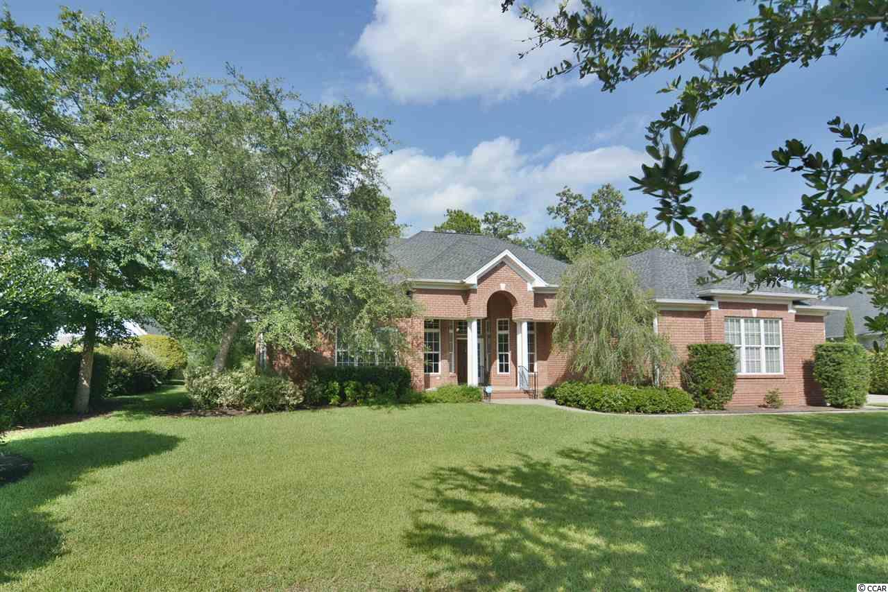 Renovated, Updated and Gorgeous! All Brick, SINGLE STORY home on over 1/2 acre lot in the GATED and prestigious neighborhood of Creek Harbour. Located in Murrells Inlet and less than 5 miles to the beach and the restaurants and shops of The Marsh Walk. Over-sized 3 car garage boasts high-lift doors, 12ft ceilings and a state-of-the-art Bendpak car lift w/ 9000lb capacity, which conveys with the house and long work bench with lots of cabinets. Easily park 4 cars in the garage when using the lift. Home renovation was completed in 2020 and now boasts fresh paint throughout, 13-15ft ceilings in living areas, high-end LVT flooring, lighted tray ceiling, 2 new fireplaces, 2 new HVAC sytems in 2017, NEW Laundry Room and Gorgeous NEW and Over-sized Carolina Room/Great Room addition built in 2018 featuring 15ft ceilings and 8ft French Doors. BRAND NEW ROOF in 2020 and Brand New Master Bath and Closet just finished in June 2020. Very Open Floor Plan with dining room, kitchen and 3 distinct living areas create a large and open feel. Enjoy the ultimate in privacy with a fully fenced, lush tree-lined backyard and extended patio for perfect outdoor living.  Amenities offered in the community of Creek Harbour include; 24 hr gated community, pool and amenity center, boating access to Collins Creek and ICW with STORAGE FOR YOUR NEW BOAT OR WATER TOYS!