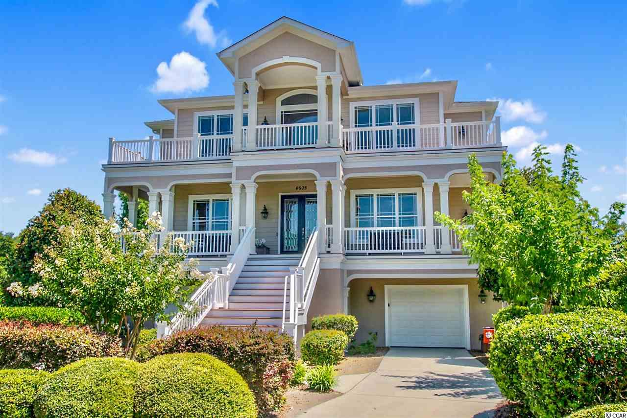 Gather your family & friends in this exquisite 4 bedroom 4½ bath custom built home in the prestigious South Island section of the gated Tidewater Plantation community. This captivating house features stunning views off the back of the house of the marsh and the 8th hole of the legendary Tidewater golf course and off the front of the house of the Intracoastal Waterway and the private South Island pool. As you enter this magnificent home you take notice of the elegance of the two story foyer and the bright open concept of the floor plan. As you continue to make your way, you begin to notice the luxurious features of the home which include hardwood, tile & carpet flooring, arched entryways, detailed ceilings, a 3 floor elevator, crown moulding, recessed lighting, cozy gas fireplace, Silhouette Blinds/Shades in all rooms, powder room, a delightful sitting area, and a grand two story living room showcasing French doors that lead out to the peaceful back deck. Prepare a fresh meal in the gourmet kitchen that offers granite counter tops, breakfast bar, stainless steel appliances, 5 burner flat cook top, double convection wall ovens, French door refrigerator with freezer drawer, custom cabinetry with under cabinet lighting, computer niche, and a large ideal pantry. Enjoy your meal in the sensational formal dining room with chair railing & a single step lighted tray ceiling. The main floor level contains the second master bedroom and provides a lighted tray ceiling, an entryway to the relaxing deck, large walk-in closet, access to a private bath with a jetted tub, vanity with dual sinks, a make up desk, and a water closet. Another stylish bedroom with a sitting area and a private bath access finishes off the main level. As you venture upstairs you will find a large & inviting loft area with gaming room with wet bar for hours of fun. Retire to the main master suite that possesses a retreat area, lighted tray ceiling, walk-in closet, and access to the master bath that boast va