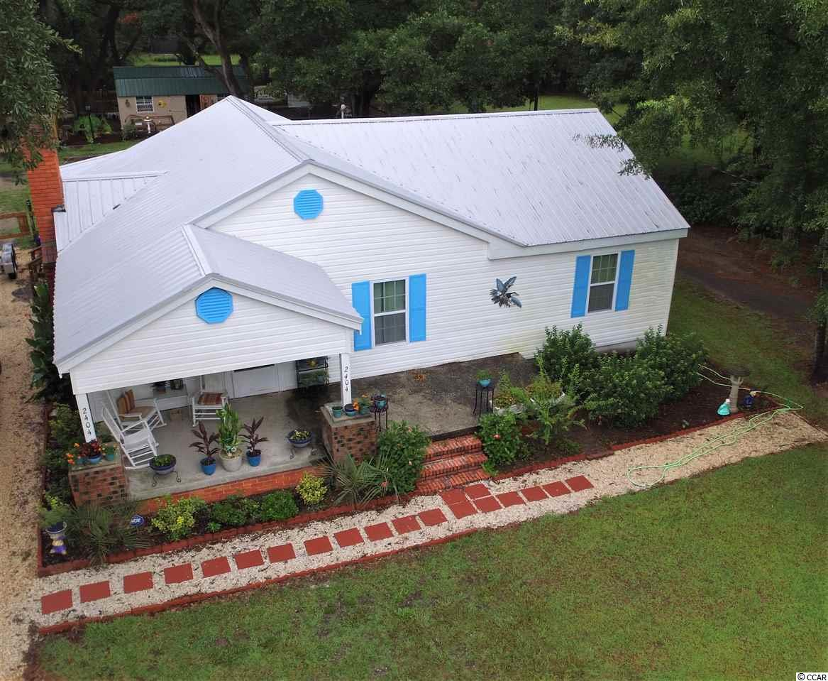 Nicely remodeled home in Maryville Farms section of Georgetown.  This home has been renovated recently including new drywall, refinished original hardwood floors and a new metal roof.  The home is spacious and comfortable with a large great room and a separate formal dining room.  On the exterior a gazebo was added to the rear of the home and the front boasts covered and uncovered porches.  The backyard features a large shed and a relaxing paver patio under the shade of the stately oaks.  Make sure to add this home to your list.  All measurements are approximate and not guaranteed.  Buyers agent should verify any measurements.