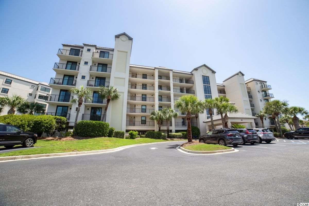 With your private stairs that lead to the pool and the beach, there is not a more perfect location for your personal slice of heaven! Welcome to your oceanfront condo at Captains Quarters in Litchfield by the Sea. This 3 BR, 3 BA unit has been recently updated with durable and stylish luxury vinyl plank flooring, new fixtures and cabinet fronts, new hardware throughout and a top quality stainless steel appliance package. Furnishings are up to the minute with a modern flair. The floorplan is easy to live in and perfect for beach parties with the newly remodeled kitchen featuring an entertaining height dining island as the anchor for the open plan. The dining area is tucked into an alcove that is extra space only found in an end unit. The living room and master bedroom pour onto the covered deck that offers easy access to and views  the pools and Litchfield Beach. The owners suite has a nicely equipped bath with double sinks, a garden tub, ample shower and water closet. The guest bedrooms (one of which is being used as an art studio) each have their own morning balconies.  The building itself has recently been improved with innovative components adding durablilty and safety and lowering necessity for maintenance. Litchfield by the Sea has become a sought-after destination in itself .... a private, gated oceanfront community with a unique amenity package included walking trails, fishing and crabbing docks, tennis, an owners' oceanfront clubhouse and observation deck, pools and of course the miles and miles of uncrowded beaches! This special place is located in Pawleys Island just an hour from historic Charleston.  Sound perfect?  It is!  Let's take a look.  And, if you need to look from afar, no worries ... there is a 3D Tour available, just ask for it!