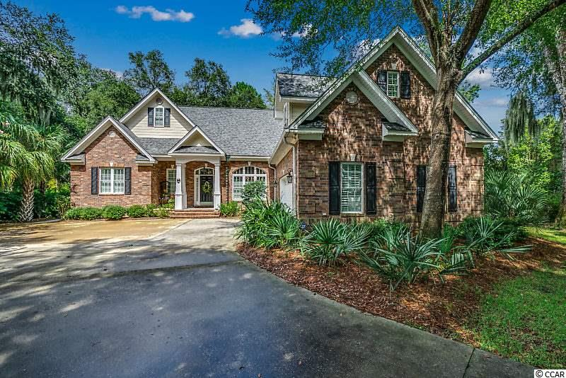 One of the finest homes in Willbrook Plantation situated on cul-de-sac with a very private lot with water view.  This beautiful full brick home with split floorplan was built in 2005 and the current owners have made many improvements and upgrades. Upon entering the home the attention to detail shows throughout with lighted trey ceilings in both the Dining Room and Master Bedroom; vaulted ceiling and gas fireplace with custom mantelpiece in the Great Room and double crown molding throughout the home.  The kitchen is truly a cook's dream with Wolf gas cooktop, all Kitchenaid stainless appliances including double ovens, refrigerator and dishwasher, granite counters and a glass subway tile backsplash.  The spacious Master Suite has upgraded bath and is situated to enjoy the outdoor living, privacy ,water views and  tranquility provided by this private location. Interior and exterior lighting and ceiling fans upgraded as well.   The outdoor living space provides a special area to experience nature with a firepit, screened gazebo and hot tub.  The brick and aluminum fencing surrounding the patio transform the area into a beautiful courtyard with space for native plantings and easily viewed through the windows across the rear of the home which create an abundance of natural lighting.    A Bonus Room upstairs is the perfect area for relaxation and TV watching.  Plantation shutters throughout.  A true  MUST SEE –  meticulously cared for with the added bonus of private access to the beaclh through Litchfield by the Sea. List of upgrades in associated documents. A list or all improvements in associated documents.