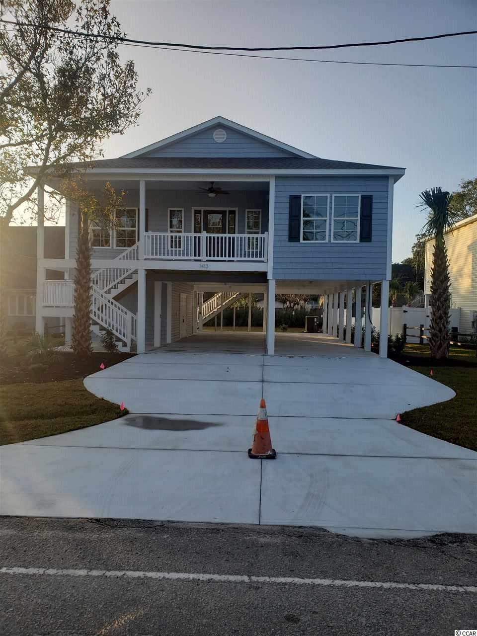 4BR / 3BA raised beach home under construction 3 blocks off the ocean in NMB - Home to feature 9 and 10' ceilings, crown molding throughout, custom cabinets with granite countertops and stainless appliance package.