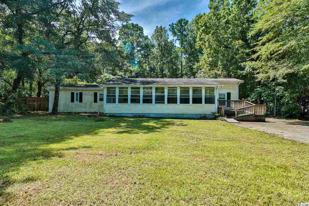 This lovely family home located on A FULL ACRE on a quiet street features a bright and spacious floor plan. The country kitchen features beautiful white cabinetry and a breakfast area plus a vaulted living room with lots of natural light! The comfortable master suite boasts plenty of space and an impressive master bathroom! There is also a large Carolina room lined with windows perfect for relaxing with friends and family! You will enjoy the private, wooded lot overlooking the huge backyard and peaceful setting! Book your showing today!