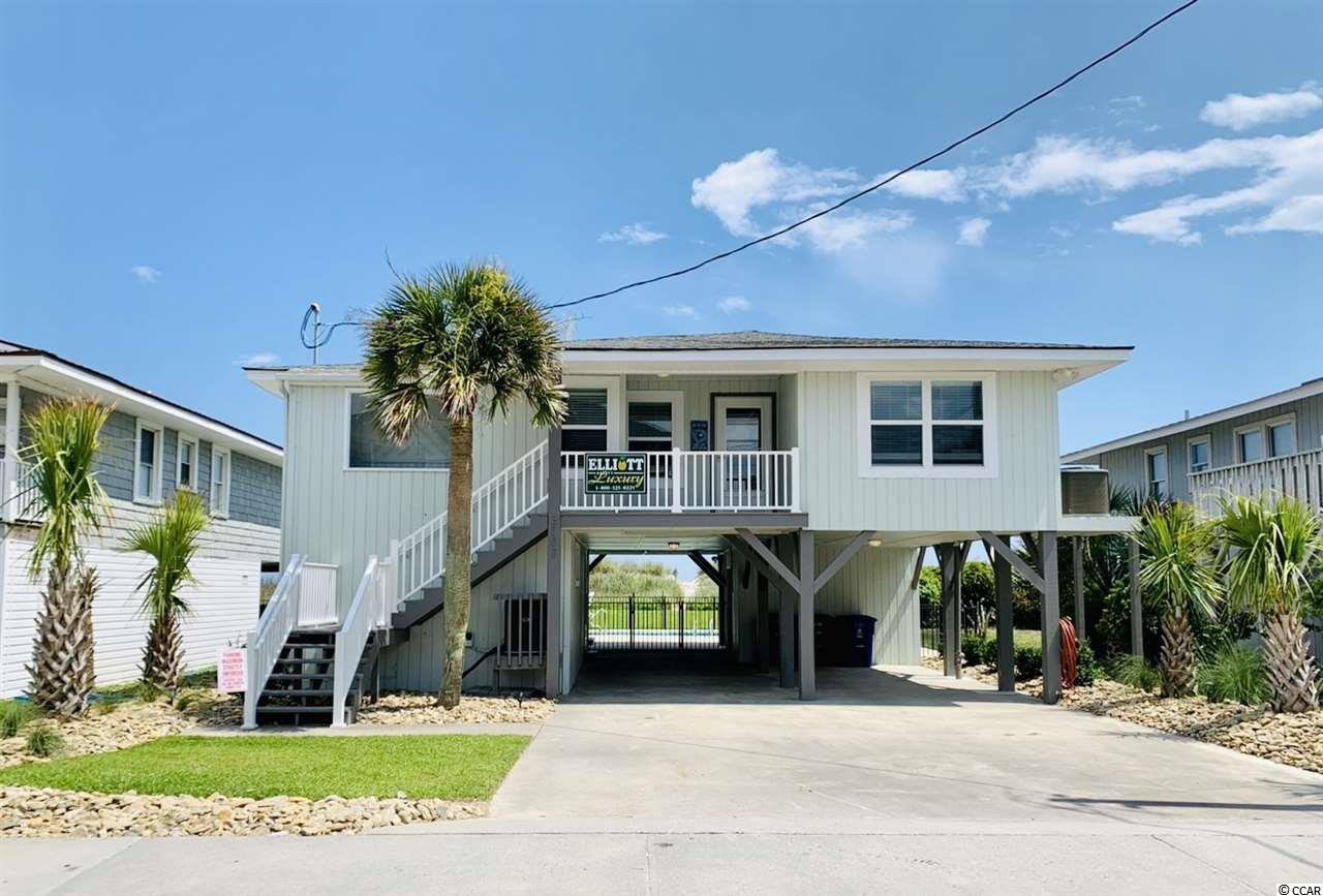 This COMPLETELY renovated 5br/3ba oceanfront home is located approximately 1 block north of the famous Cherry Grove Pier and is in the heart of one of the most established areas along the Grand Strand. From the minute you walk into this charming family beach home, you will be greeted with some of the best views along the Cherry Grove Beaches. Your family and friends will be able to sit on the 26 x 8 covered porch and watch some of the most beautiful sunrises SC has to offer. If you are planning a large family gathering, this awesome home features a huge yard with inground  pool overlooking the ocean which can host family reunions or just beautiful evenings overlooking the Atlantic Ocean. The main level is an open floorplan offering incredible views. The master bedroom, two more bedrooms and two baths are upstairs, and two bedrooms and another bath are downstairs. This raised beach style home offers plenty of parking under the home with additional space in front. Also located downstairs is a large storage area for all of your beach and golf needs. Main street and all of the attractions of N. Myrtle Beach are located less than 10 minutes away. If you are looking for the perfect place to call home here in Cherry Grove/North Myrtle Beach, this is it!!