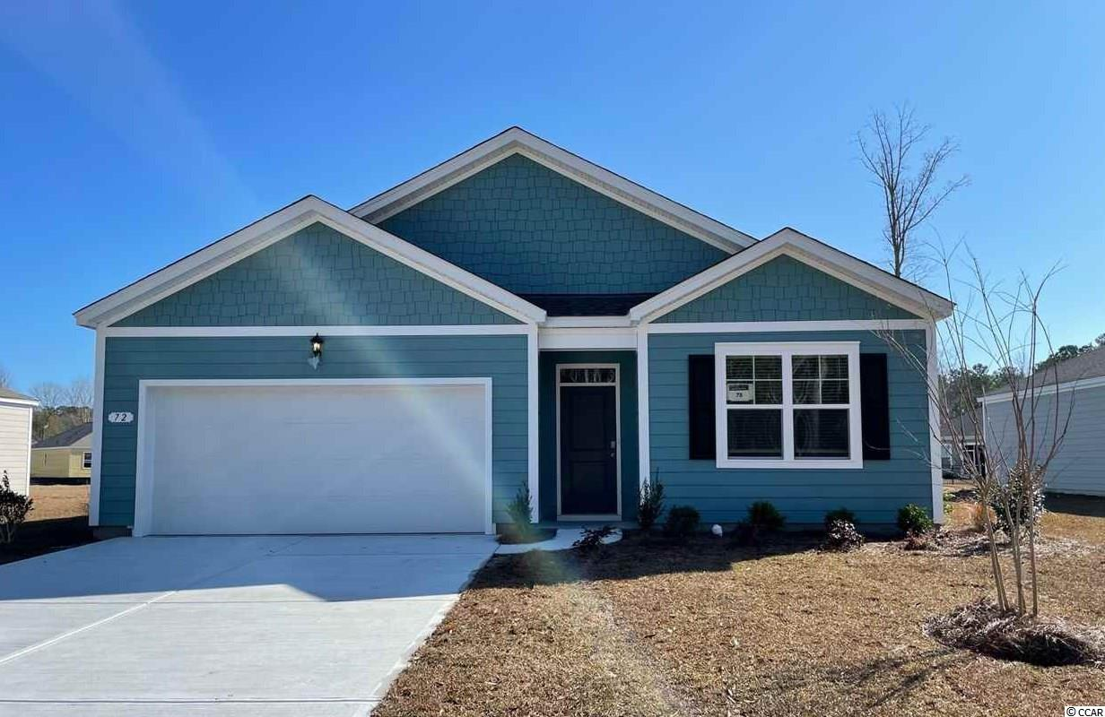 The popular Cali floorplan is now available in Hammock Cove! This plan is the perfect one level home with a beautiful, open concept living area for entertaining. The kitchen features white painted cabinets, granite countertops, an oversized island with breakfast bar, a walk-in pantry, and stainless Whirlpool appliances. The large owner's suite is tucked away at the back of the home, separated from the other bedrooms, with double vanity and 5' walk-in shower in the en suite bath. Beautiful wide plank laminate flooring flows throughout the main living areas and offers the look of wood with easy care and cleanup. Spacious covered rear porch adds great outdoor living space with water views! Ask about our Home Is Connected smart home package that is also included! Hammock Cove is the place you want to call home! Just moments away from beaches, marinas, dining, golf courses, shopping, and hospitals. If you are interested in downsizing, up-sizing, or if you would like to add a pool and create your own outdoor living space, Hammock Cove has the homesite and home for you.  *Photos are of a similar Cali home. (Home and community information, including pricing, included features, terms, availability and amenities, are subject to change prior to sale at any time without notice or obligation. Square footages are approximate. Pictures, photographs, colors, features, and sizes are for illustration purposes only and will vary from the homes as built. Equal housing opportunity builder.)