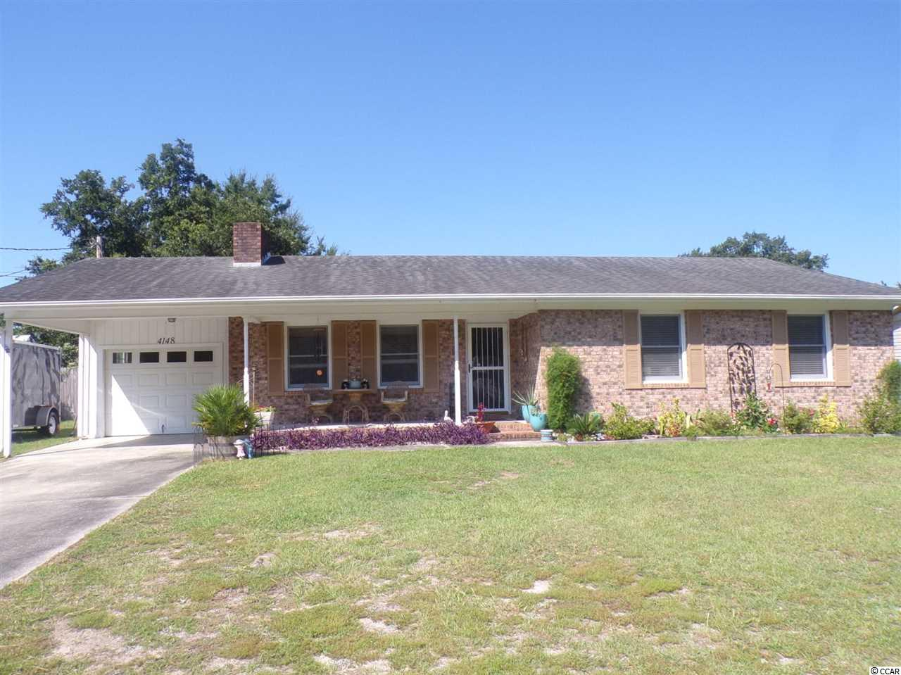 This beautiful 3 bedroom, 2 bath brick  home is on a spacious fenced in lot.   French door slate refrigerator and other matching appliances.  The large kitchen has lots of storage space!  Crown molding in every room! Large screened in porch!  No HOA and is in a beautiful community!  Don't miss this home close to the beaches, restaurants, and the Little River waterfront!  This home is also handicapped accessible.