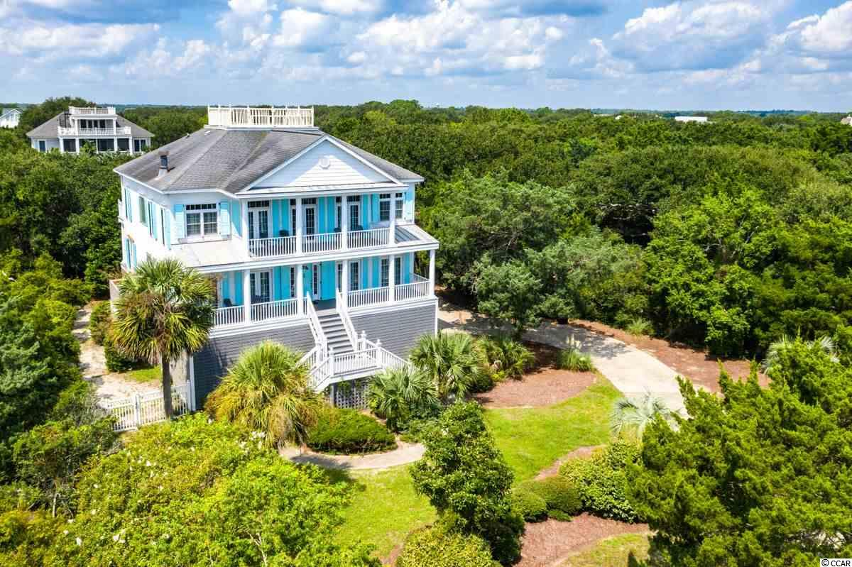 Awesome 5 BR vacation home or primary residence right across the street from DeBordieu Beach. The main floor features an open floor plan, master suite, and access to a roof top deck where you can watch the sun come up over the Atlantic, and set over the creeks and marshes of North Inlet. The first floor features 4 guest rooms, each with private en suite baths. Surrounded by beautiful Live Oak and Cedar trees, and offered fully furnished, the features of this inverted floor plan include: Elevator, Wood floors, Screened porch, Office with built-in desks and bookshelves, generous closets, fireplace, pool table, and foosball table. Popular on the DeBordieu Rental Program, there is room enough in the fenced back yard to add a pool if desired.  DeBordieu Colony is an oceanfront community located about an hour north of Charleston, South Carolina, just south of Pawleys Island, featuring private golf and tennis, saltwater creek access to the ocean, a manned security gate, and luxury homes and villas surrounded by thousands of acres of wildlife and nature preserves. People who have been here say there is no place like DeBordieu. Come see for yourself!
