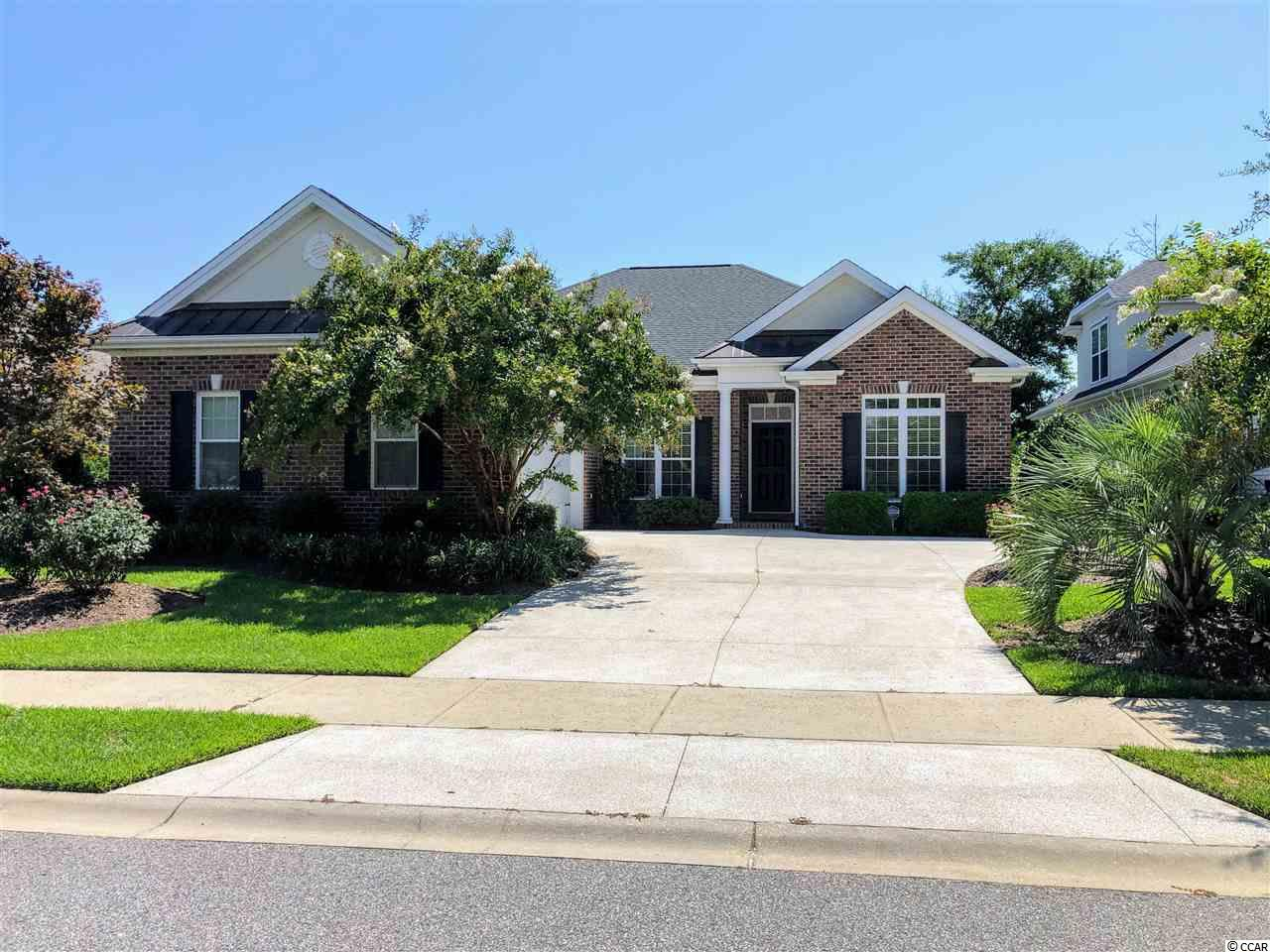 """This is a must see at 867 Marsala Drive, Cipriana Park at Grande Dunes.  Quick highlights: all brick exterior, most popular plan that has been added to, dead center of a beautiful lake, only used as a second home and Grande Dunes finest amenities!! More details?  Ok.  The Sabal offers 3 bedrooms, 2 full baths and a powder room.  The formal dining room is currently being used as a den.  The kitchen offers an abundance of cabinets and counter space, with a large breakfast area.  The open and bright floorpan was made even larger with a 2ft addition in depth across the entire plan AND an 18x10 sunroom, that looks out to the finest lake view available.  Distinctive """"wood look"""" tile through the living areas, extensive trim and moldings throughout and incredible coffered ceiling in the great room.  The owners suite is massive, with triple windows that look at the lake, large walk-in closet and beautiful bath, with custom tile was-in shower.   This is all located in one of the most desired neighborhoods in Myrtle Beach.  Steps to the private Ocean Club, Marina, tennis and Fitness Club.  Also, so convenient to shopping, dining and medical facilities, they are all actually within 2 blocks of home. Home is perfect, only used as a second home, possible it has not been slept in 300 nights.  A must see."""