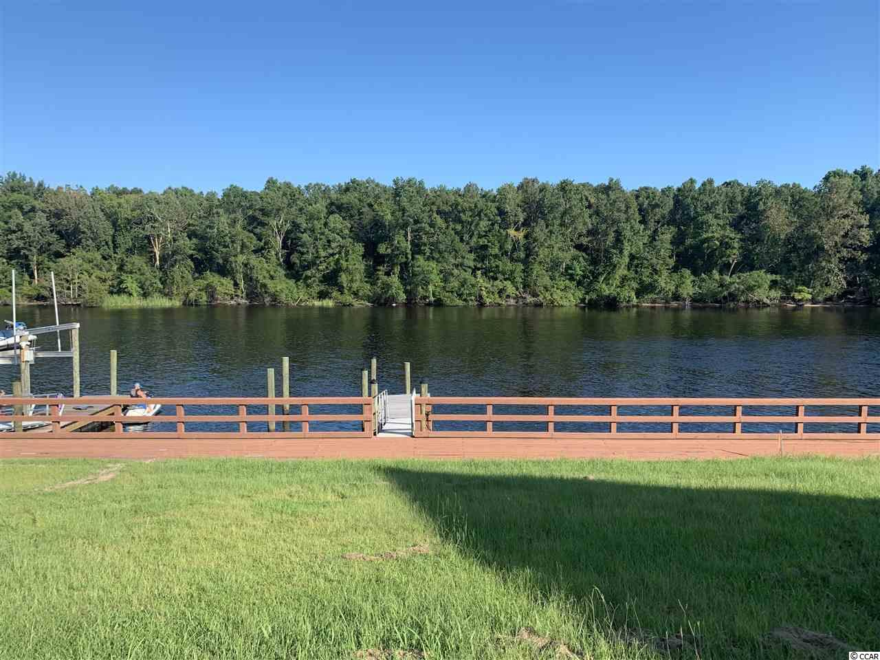Waterfront with a community Day dock, boat ramp and boat storage. Lot has been dredged and has permit for individual private dock if desired. Spoil Yourself in this Gated Waterfront Community with Deepwater access and enjoy all the  Intracoastal Waterway has to offer... Rare opportunity to find all of this in one place...come live the waterway dream...you deserve it!