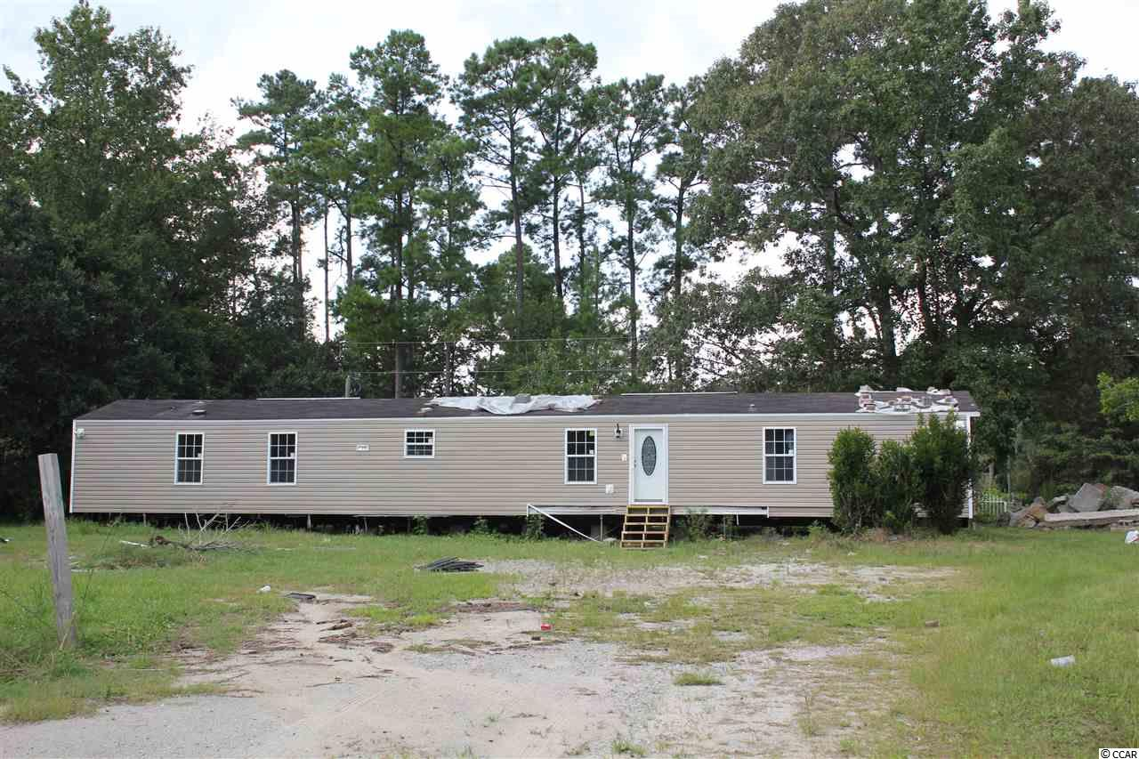 INVESTOR ALERT!!!  Partially remodeled single wide close to the river.  Home sits on .65 acres and has new floors, tile showers, windows, and siding.  Call your agent today to schedule a showing.