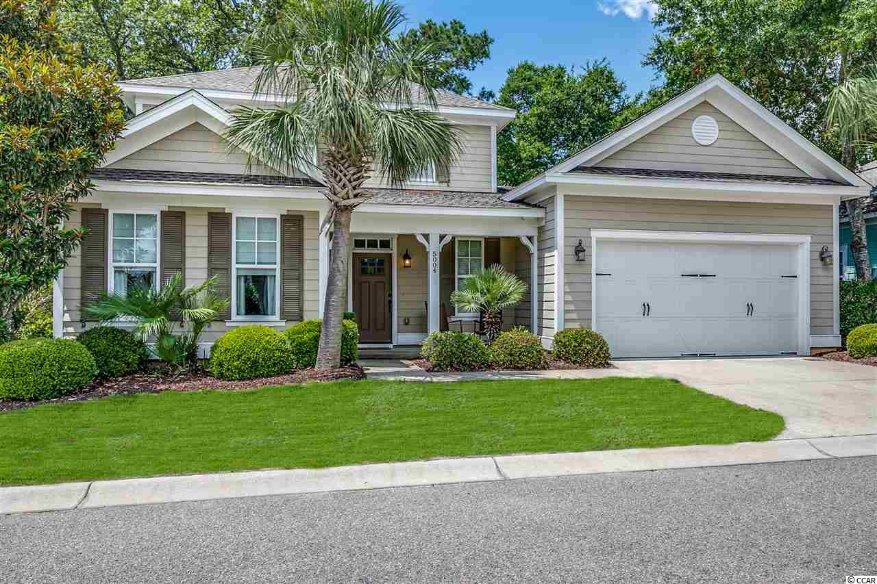 "Former MODEL HOME with tons of upgrades NOW available for sale.  5004 Old Appleton Way is located in the prestigious oceanfront community called North Beach Plantation in North Myrtle Beach, SC.   This beautiful, turn-key 3 bedroom / 2.5 bath home is being sold furnished (with just a few exceptions) and the furnishings are better quality since this home has NEVER been a rental property.  The current owners are the original owners and have ONLY used it as a 2nd home.   Some outstanding features of your new home include:  Hardi-plank exterior siding * Smooth ceilings throughout * Entry foyer with coat closet and extra storage * Levered door handles throughout * Decorative tile floors everywhere except the 3 BR's and 2nd floor landing that are carpeted * Separate laundry room with 42"" cabinets and molding * High ceilings.    There is a 1st floor owner's suite with an en-suite bathroom, ceiling fan, and a large walk-in closet.  The bathroom has double sinks with marble sink tops, framed mirrors, and decorative seashell lights, as well as a tiled shower with a transom window above, and a water closet.  Upstairs are the 2 guest suites with a full guest bathroom.  Both bedrooms have ceiling fans with light fixtures and the guest bathroom has tiled floors, granite sink top, a framed mirror, frosted goose-neck lights, and a tub/shower combo.  The over-sized 2-car garage is spacious with high ceilings - plenty of room for both cars and your beach bicycles.   The main living area is all open - ideal for entertaining.  The kitchen features granite counter tops with a raised bar counter, goose-neck faucet, and under-mount sink; plenty of cabinets; recessed lights; a computer desk area; and all stainless steel appliances (refrigerator, dishwasher, smooth-top stove / oven, and microwave).   There is a dining area with plenty of room for a 6-8 person table.   The living room has a cathedral ceiling, recessed lights, a ceiling fan, and gorgeous furniture.  Off of the living room is a 1/2 bath.   The back yard area is highlighted with the LARGE screened-in porch with its cathedral wood-paneled ceiling with recessed lights and a ceiling fan, the brick-pavered rear patio for your grill, and the shaded yard under the sprawling arms of the amazing live oak tree.  I'd take this home in ANY location but it doesn't hurt that it's located within the 60-acre OCEANFRONT community of North Beach Plantation that features: A 2.5 acre outdoor pool oasis with a swim-up pool bar, 5 hot tubs, 8 pools, and a lazy river; a Day Spa; Fitness Center; onsite security; and 3 restaurants located onsite.  Across the street from the community is Barefoot Landing, home to over 120 shops and restaurants.   5004 Old Appleton Way is waiting for you to come and enjoy the luxury lifestyle this home and this location affords."